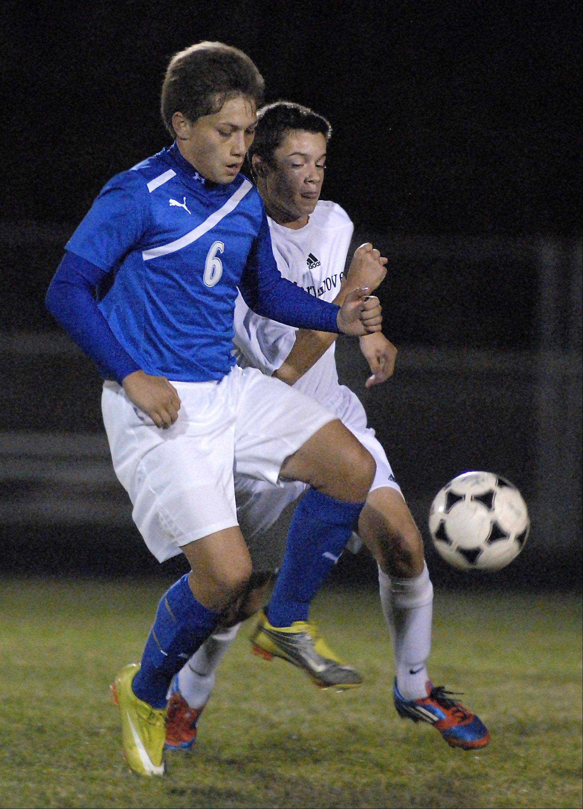 Cary-Grove's Dale Opasser rivals Dundee-Crown's Alex Ramirez for the ball in the first half on Tuesday, October 2.