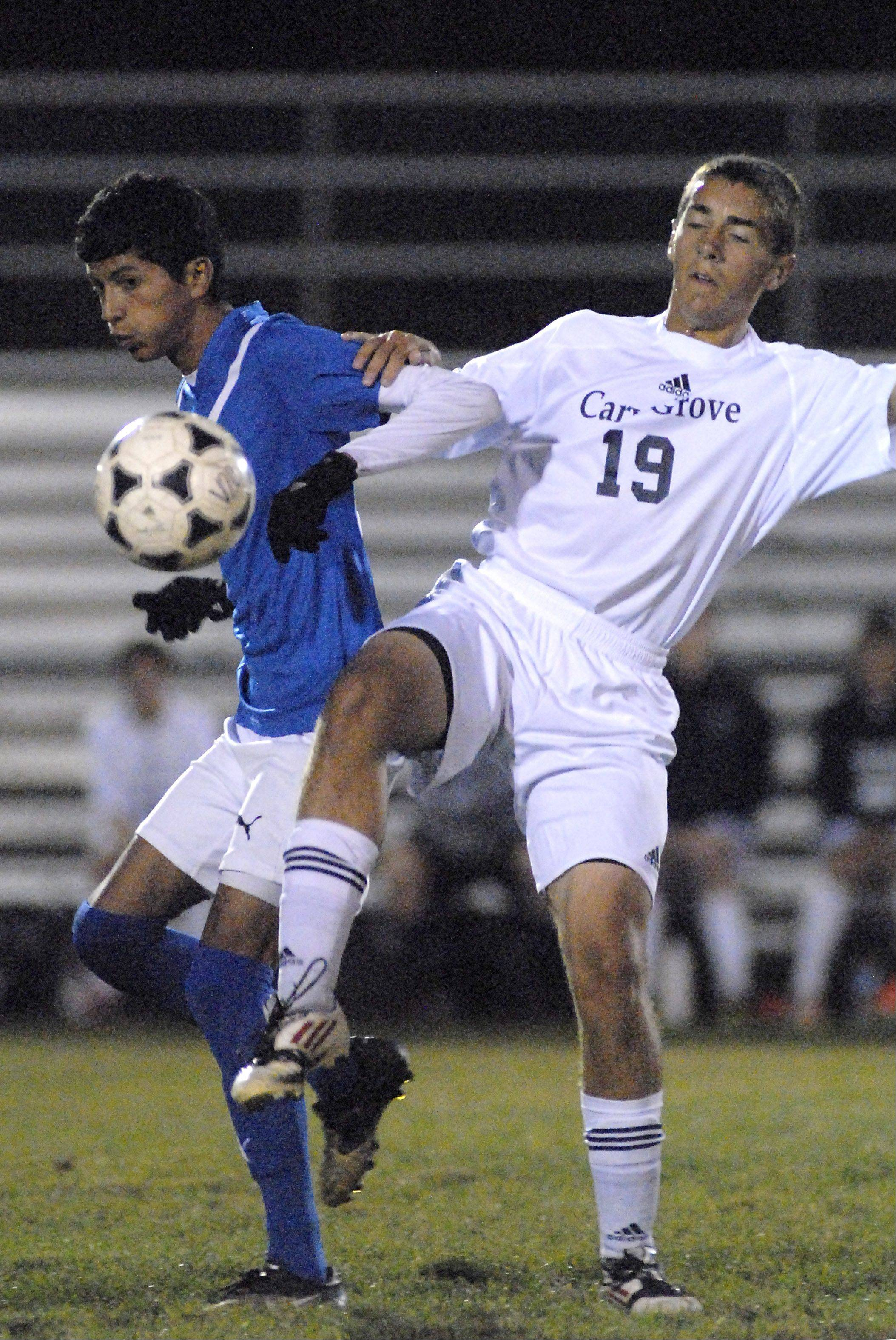 Dundee-Crown's Franciso Nava and Cary-Grove's Joey Klawitter collide while fighting for the ball in the first half on Tuesday, October 2.