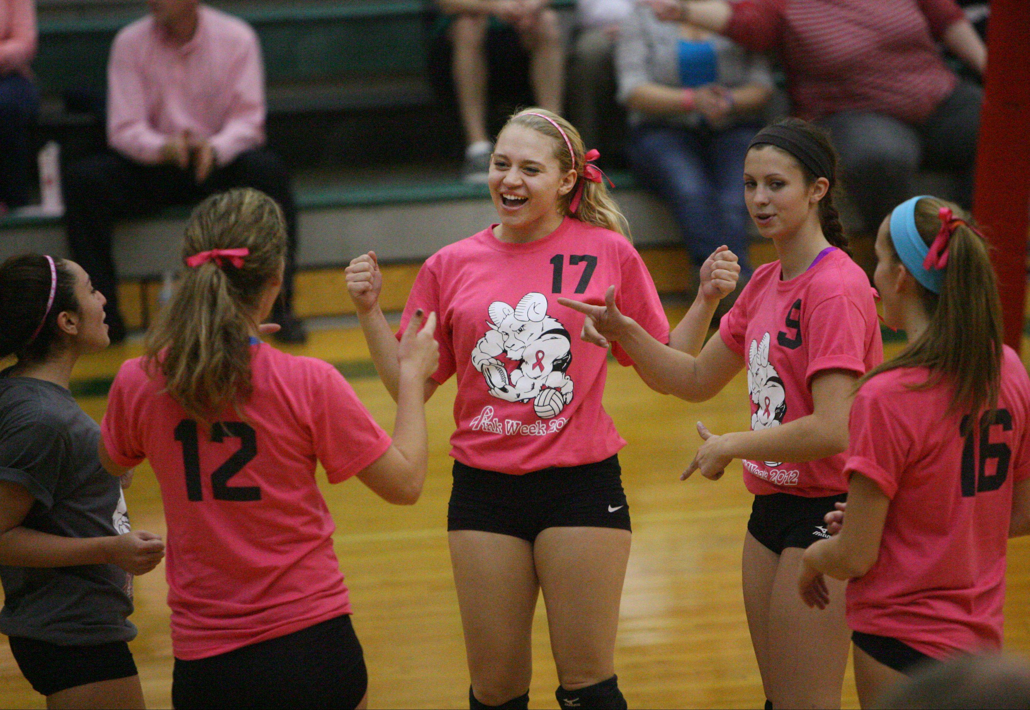 Grayslake Central's girls volleyball team dressed in pink for its contest against Woodstock to bring attention to National Breast Cancer Awareness Month on Tuesday at Grayslake Central.