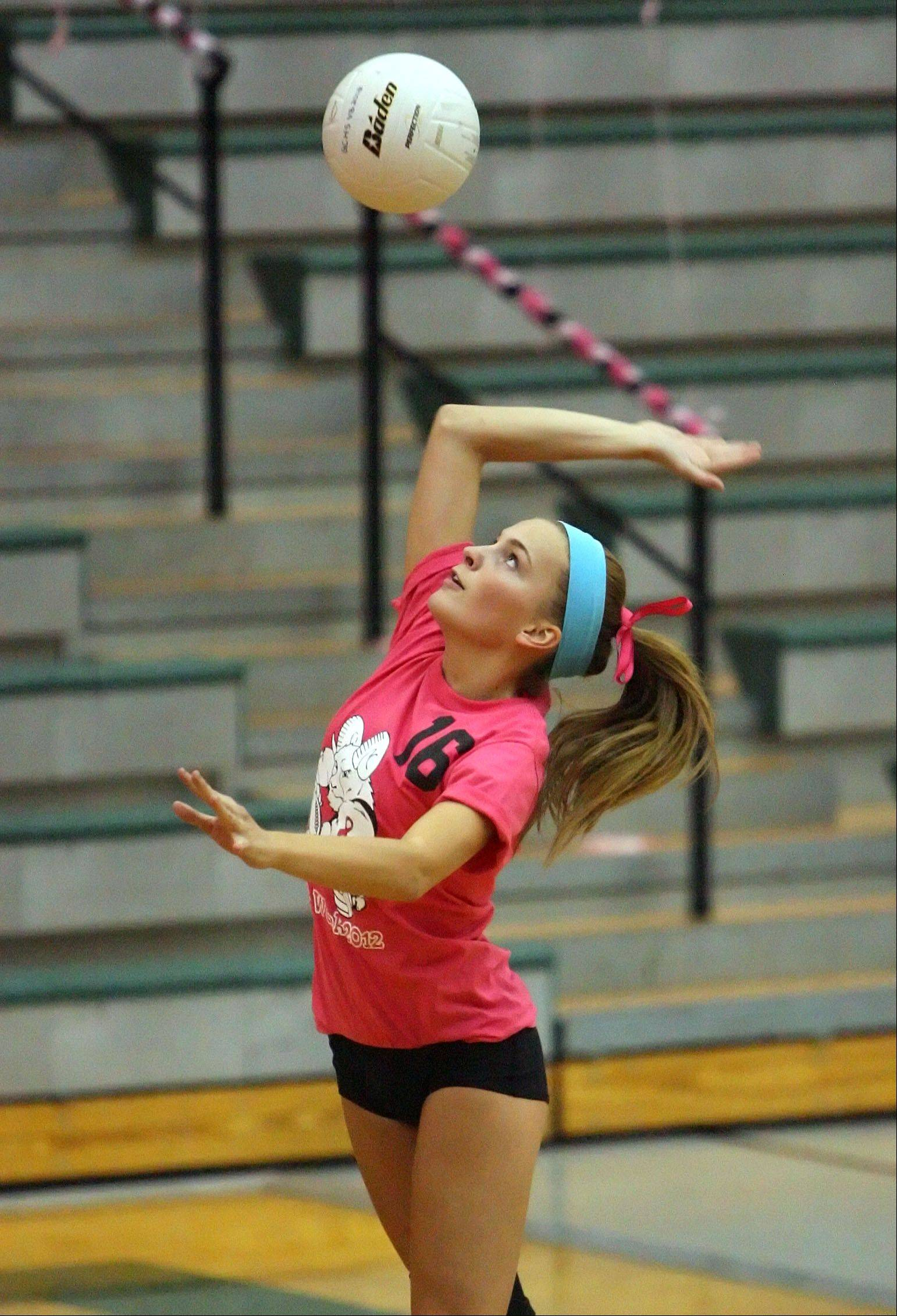 Grayslake Central's Meghan Brewster serves against Woodstock on Tuesday at Grayslake Central.