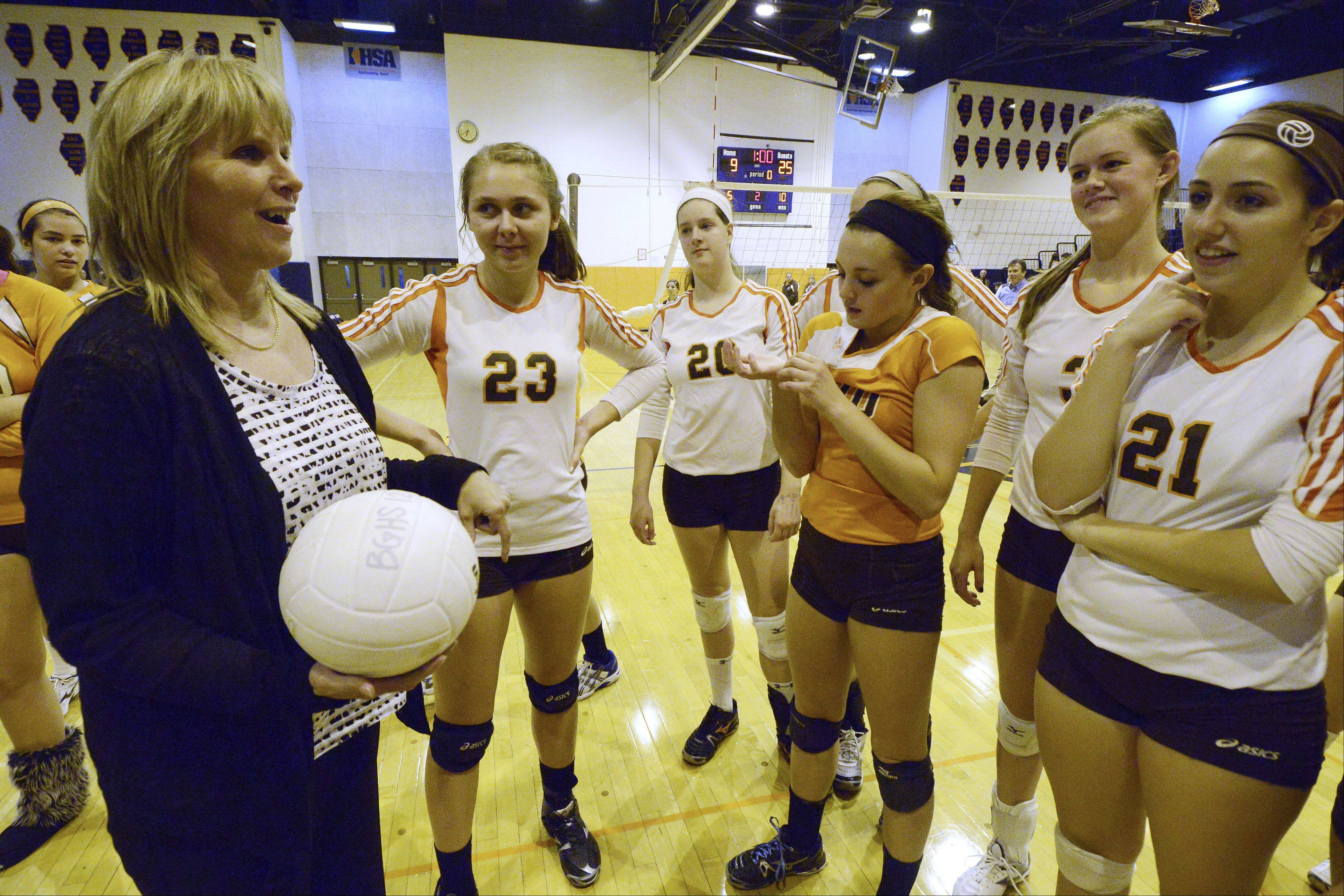Hersey girls volleyball coach Nancy Lill thanks her team after earning her 800th career coaching victory during the Huskies' MSL East-clinching effort Tuesday at Buffalo Grove.