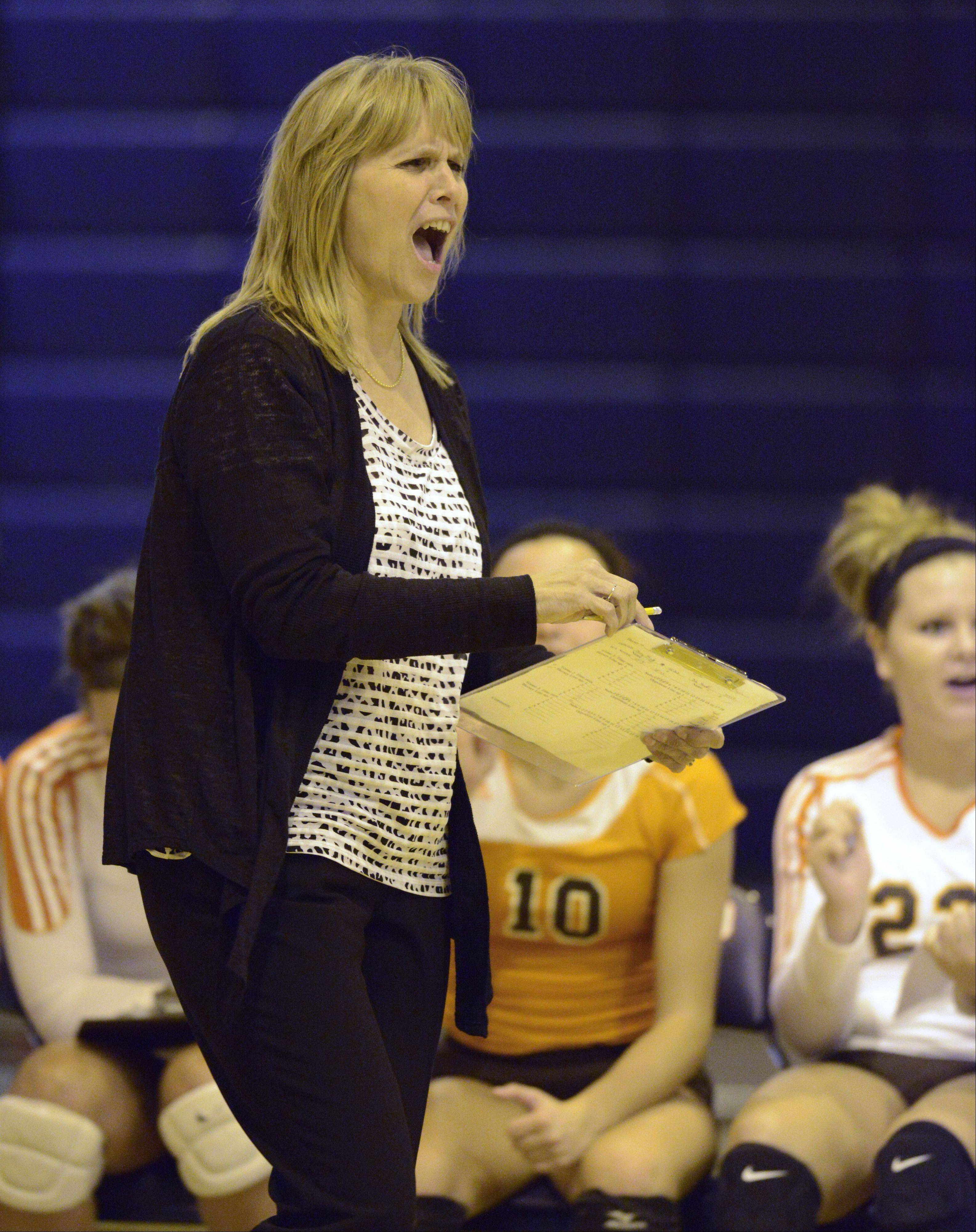 Hersey girls volleyball coach Nancy Lill leads her team on her way to earning her 800th career coaching victory during the Huskies' MSL East-clinching effort Tuesday at Buffalo Grove.