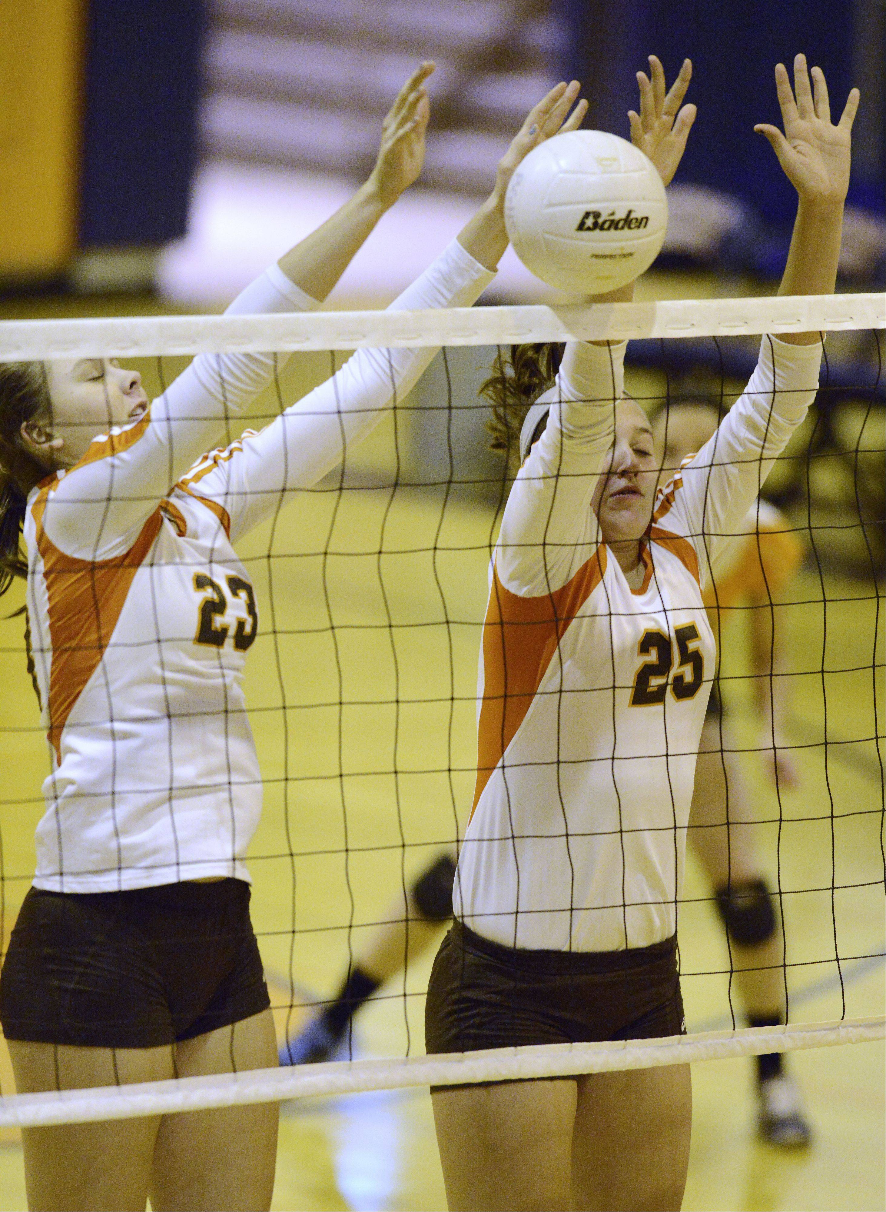 Hersey's Liz Fuerst, left, and Gabriella Olhava block the ball at the net during Tuesday's game against Buffalo Grove.