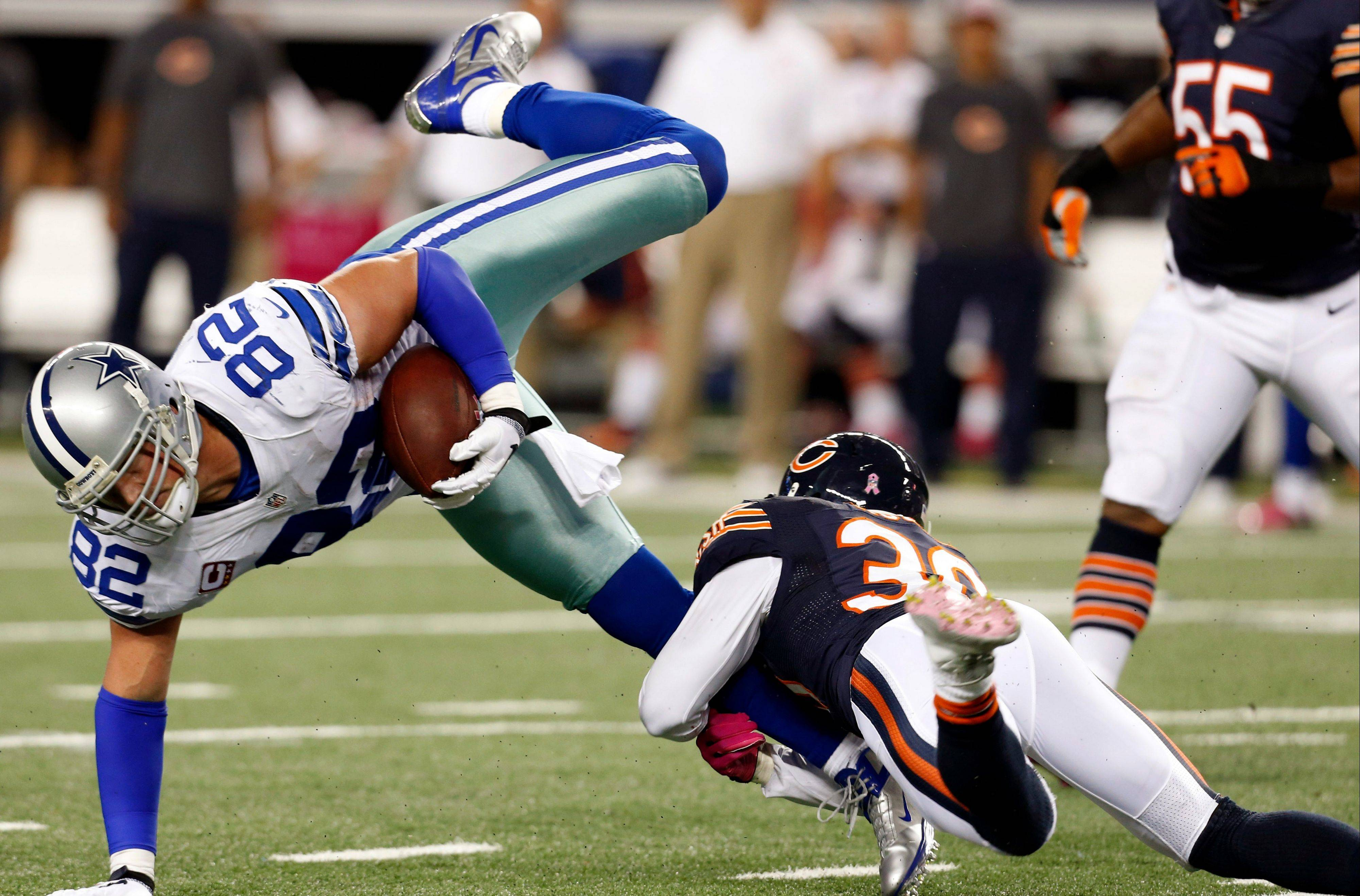 Cornerback D.J. Moore tackles Cowboys tight end Jason Witten in Monday's 34-18 Bears victory. Moore picked off his first pass of the season and finished with 10 tackles.