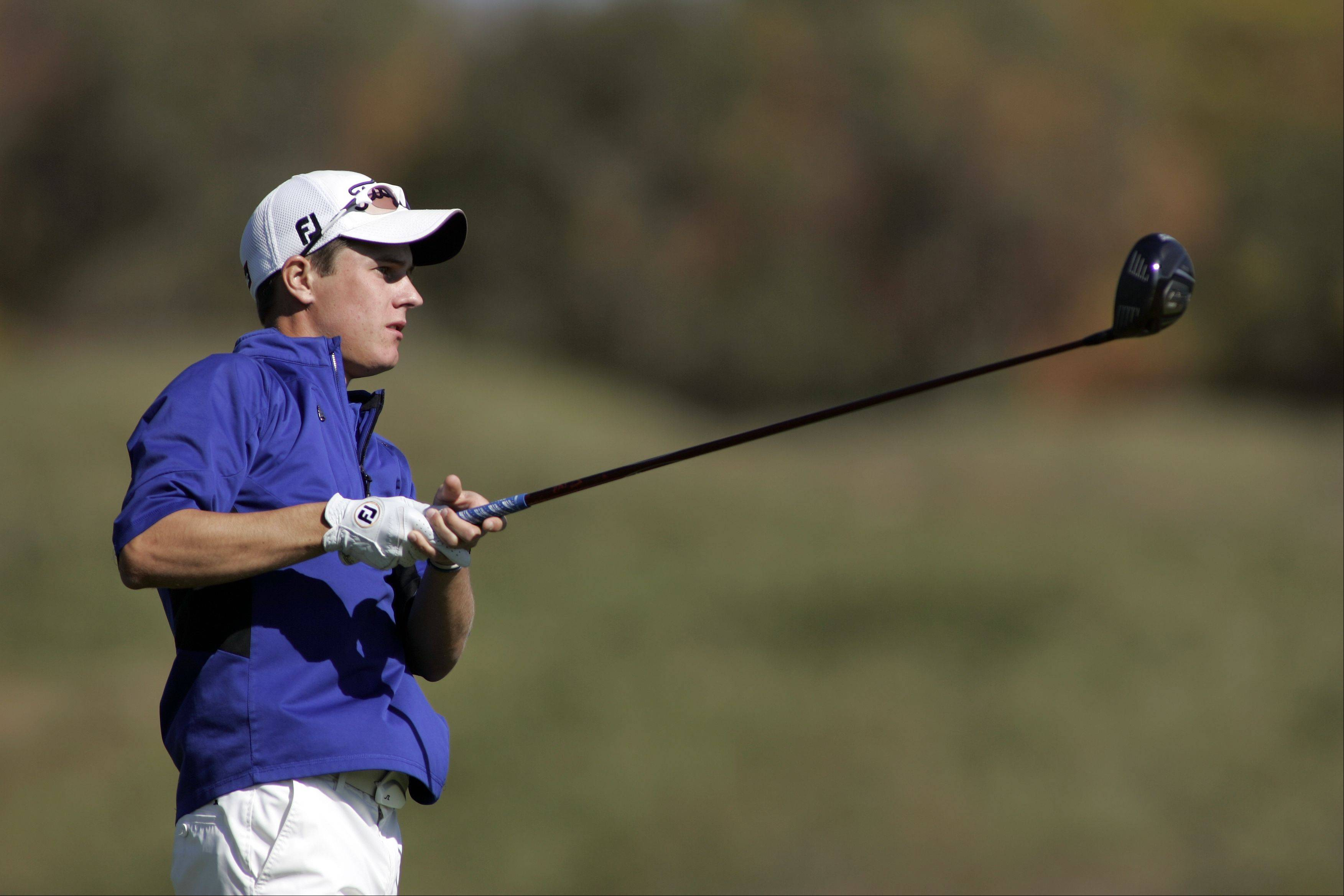 Geneva's Colin Lillibridge watches his tee shot on the 11th hole during the Larkin boys golf regional at The Highlands of Elgin Golf Course Tuesday October 2, 2012 in Elgin.