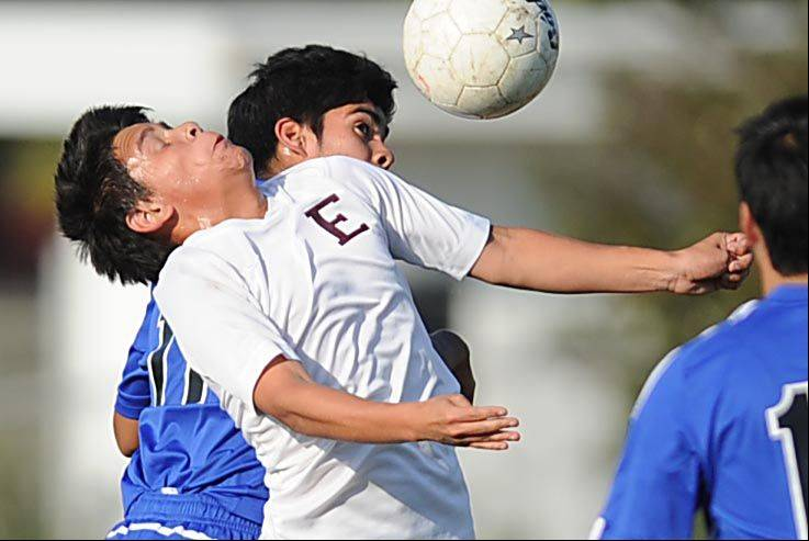 Elgin's Joel Chavez is bumped by Larkin's Diego Ramirez as they compete for a header Tuesday at Memorial Field in Elgin.