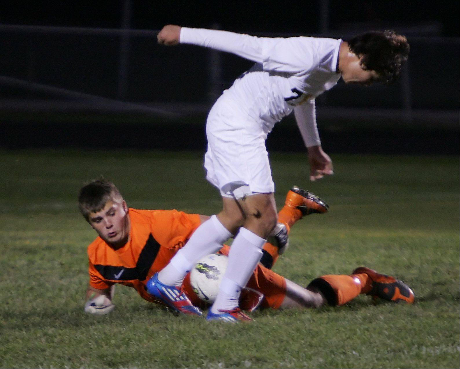 Antioch goalie Tommy Ttitschler stops the advancement of Round Lake forward Mauricio Salgado Thursday.