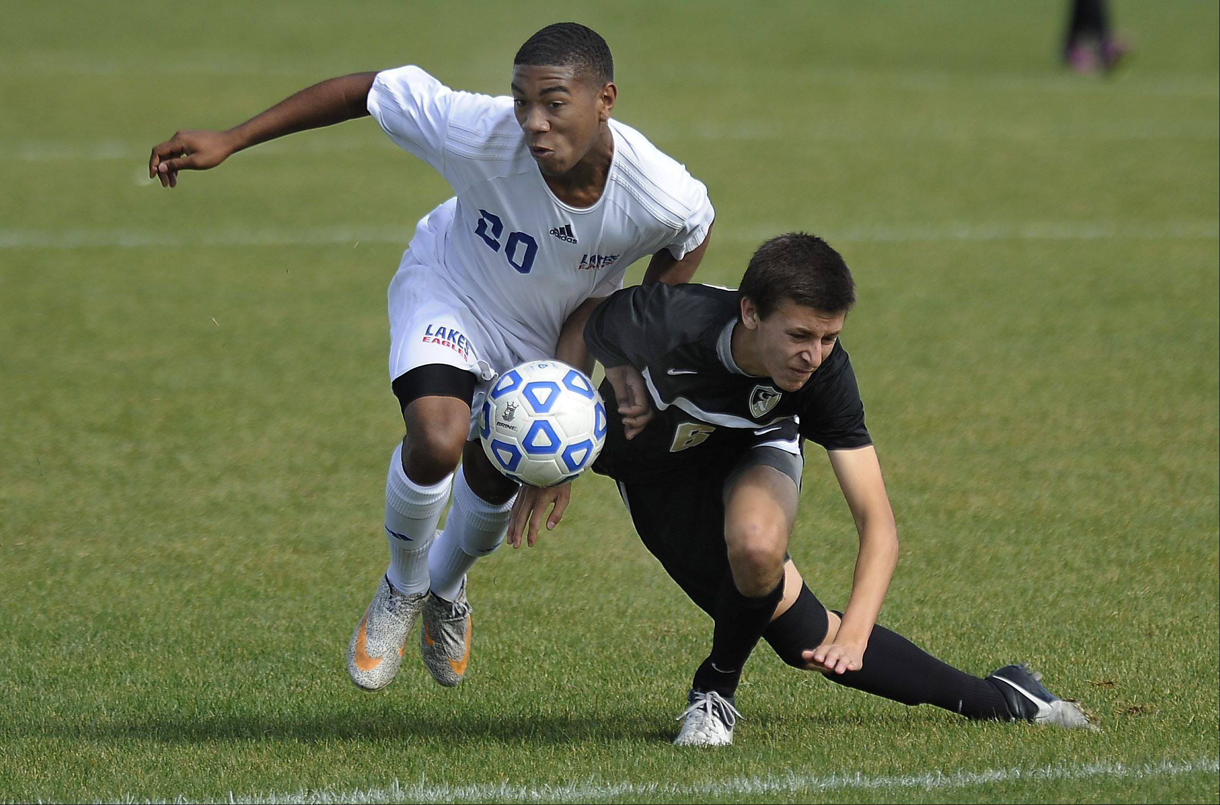 Lakes' Foster Dore and Graylake North's Andreas Thedorf battle for control during Saturday's soccer game in Lake Villa.