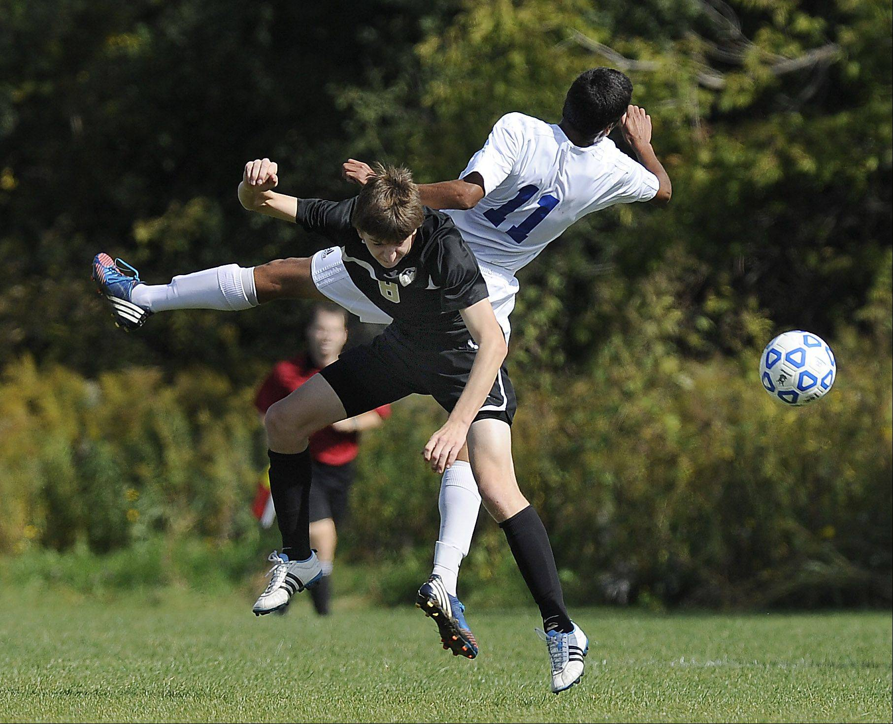 Lakes' Caleb Arnwine collides with Graylake North's Nick Rice Saturday in Lake Villa.