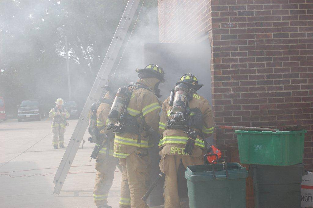 Lombard Fire Department firefighters and paramedics during a recent training drill, which included nearby fire departments.