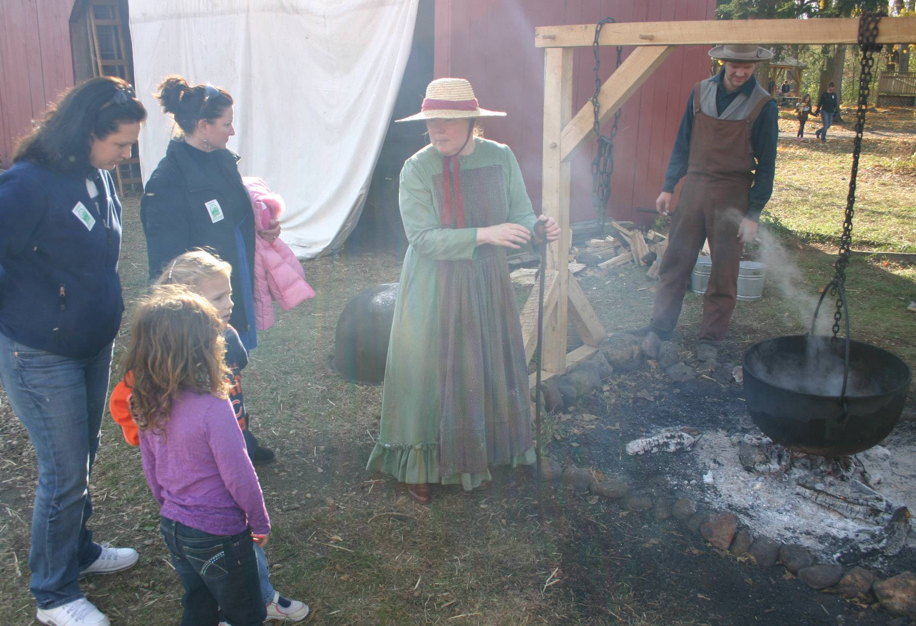Visitors learn about the process of bringing food to tables in the 1880s at Heritage Farm at Spring Valley.
