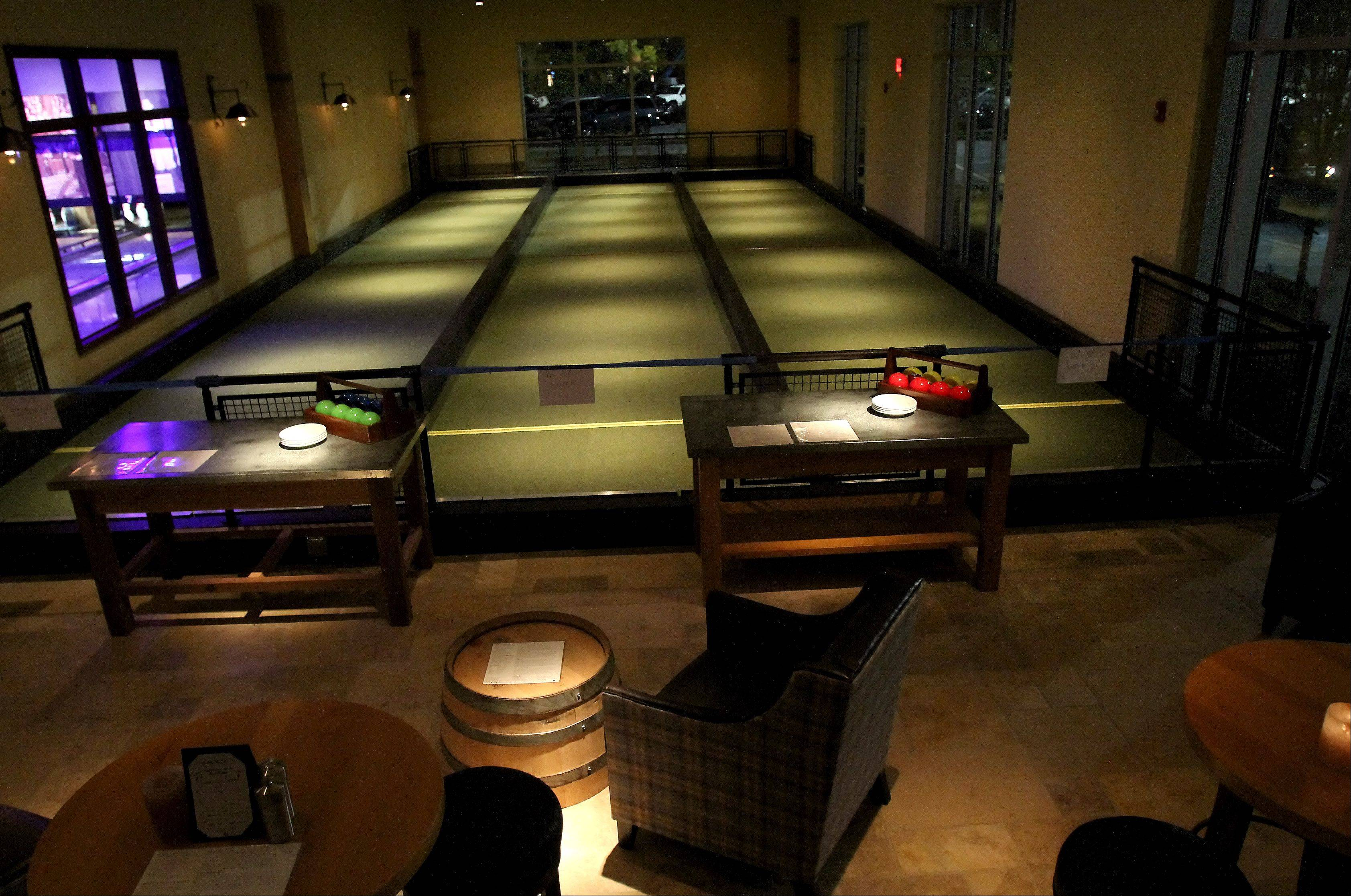 Playing bocce is one of many entertainment options at Pinstripes.