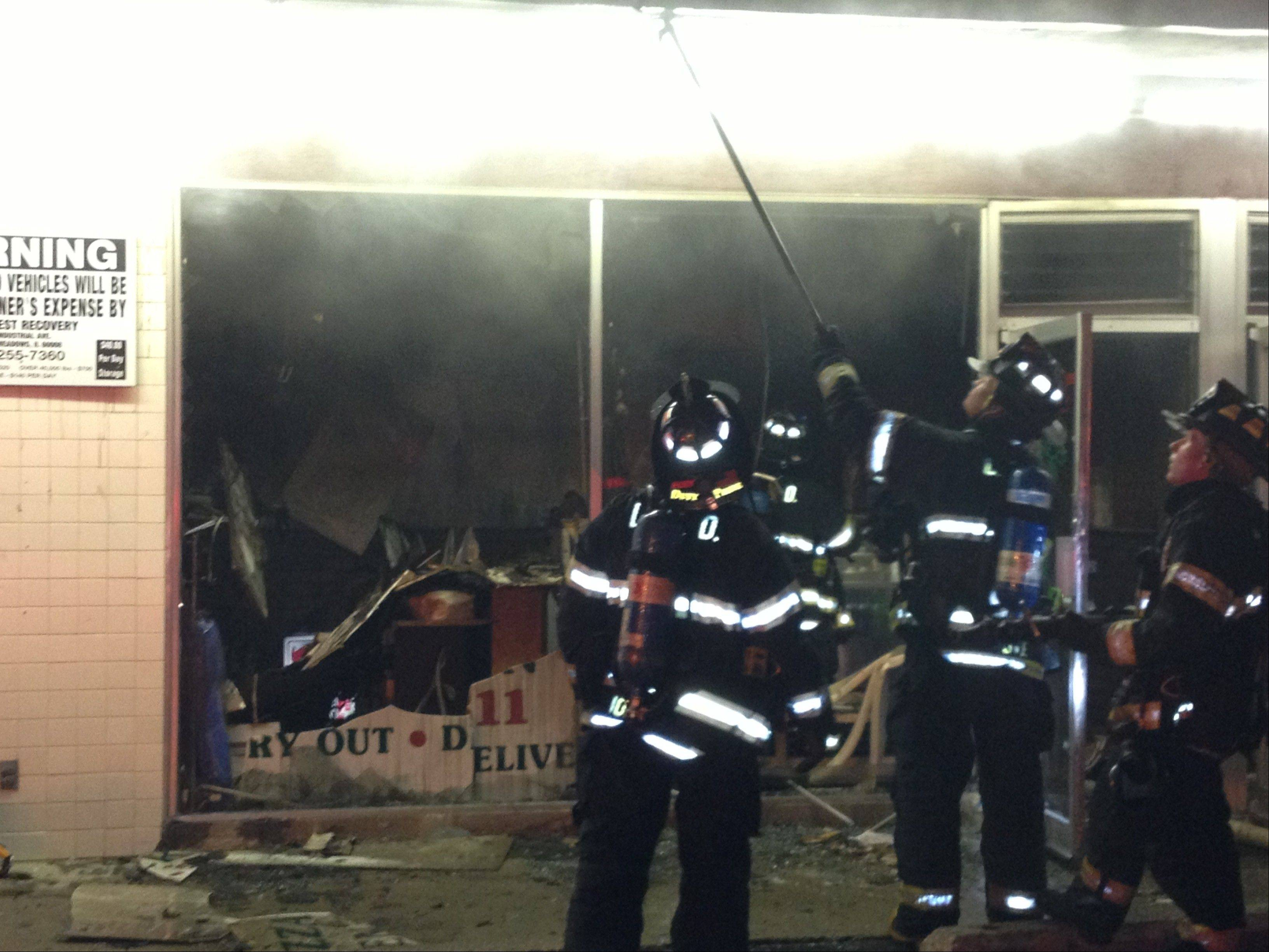 Des Plaines firefighters Wednesday battled an early morning blaze that engulfed Mugavero's Pizza & Ribs, 600 Central Road in Des Plaines. No one was injured but the restaurant suffered extensive damage and will remain closed for some time, officials said.