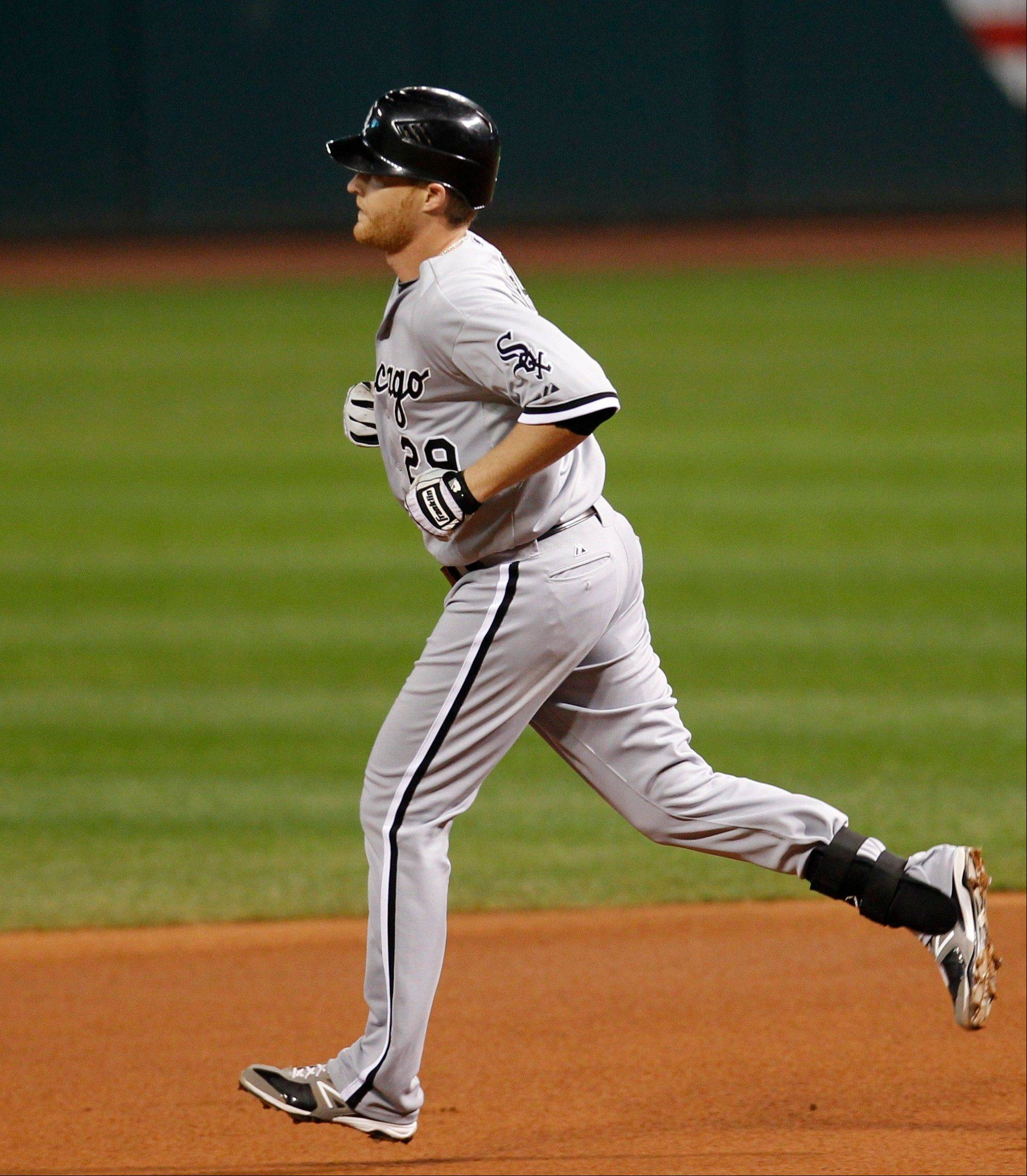 Chicago White Sox's Dan Johnson runs the bases after hitting a two-run home run off Cleveland Indians starting pitcher David Huff in the second inning of a baseball game, Wednesday, Oct. 3, 2012, in Cleveland. Dayan Viciedo scored. The White Sox won 9-0. (AP Photo/Tony Dejak)