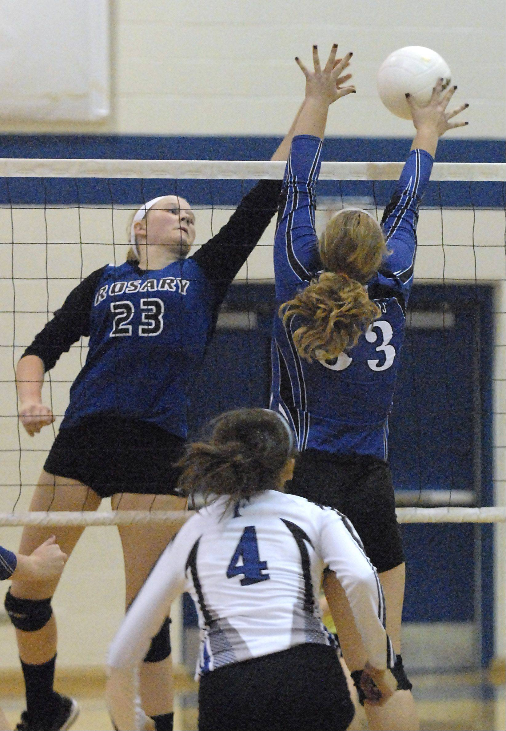 Rosary�s Michaela Ping tips the ball over the net toward St. Francis� Casey Salandra in the first game on Wednesday, October 3.