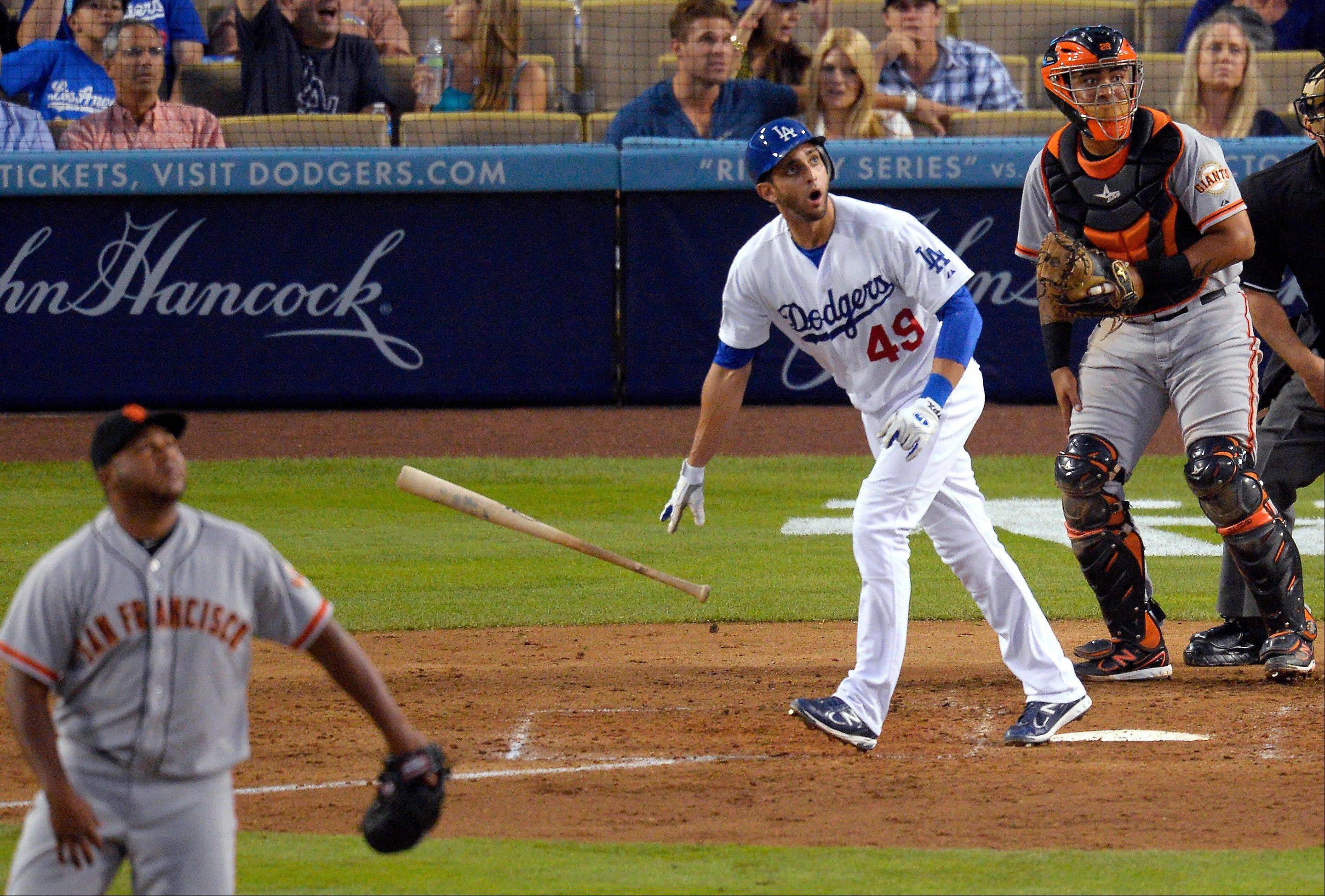 The Dodgers� Alex Castellanos, center, watches his solo home run off San Francisco Giants relief pitcher Jean Machi during the eighth inning Wednesday in Los Angeles.