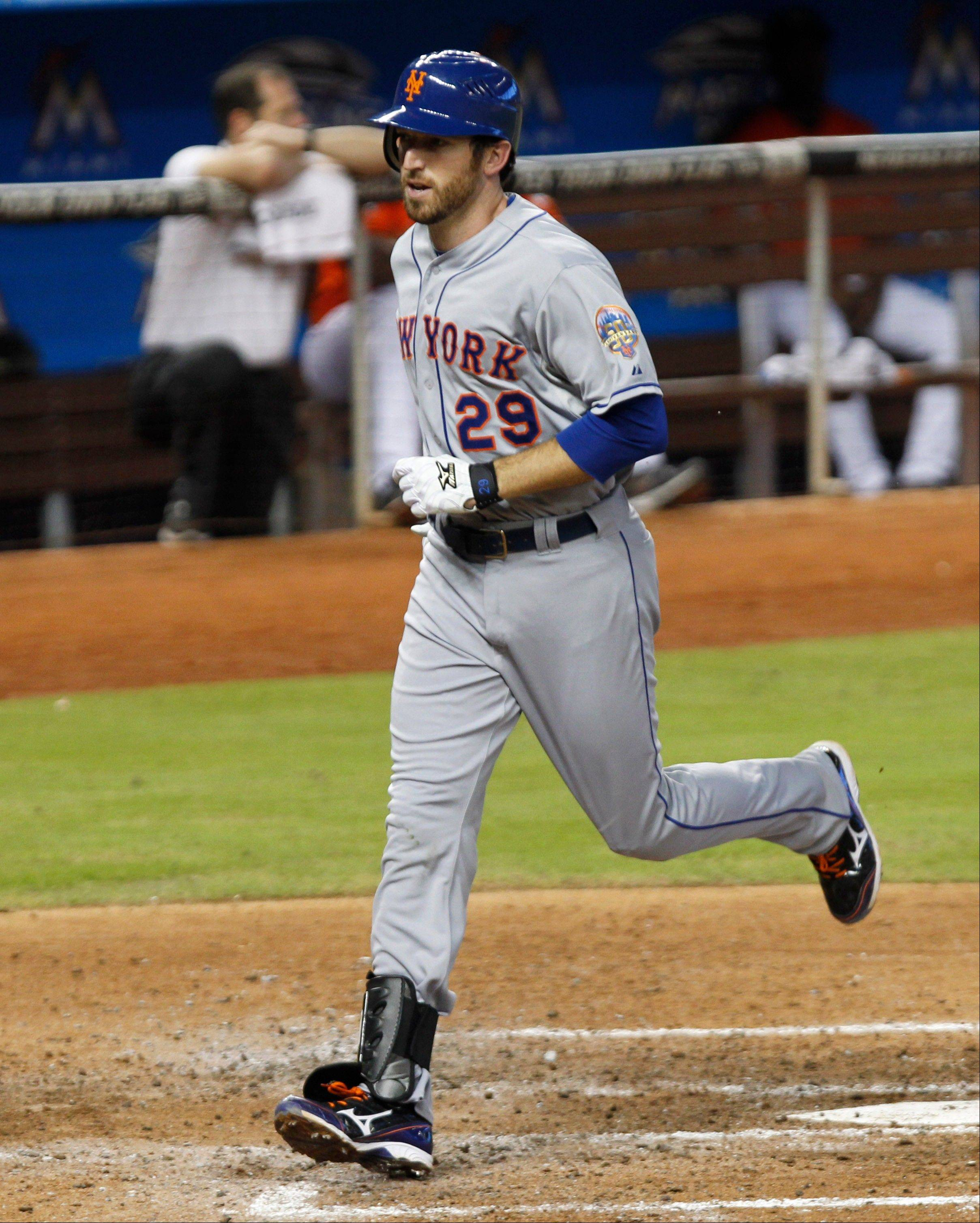 The Mets� Ike Davis crosses home plate after hitting a solo home run against the Marlins in the sixth inning Wednesday in Miami.