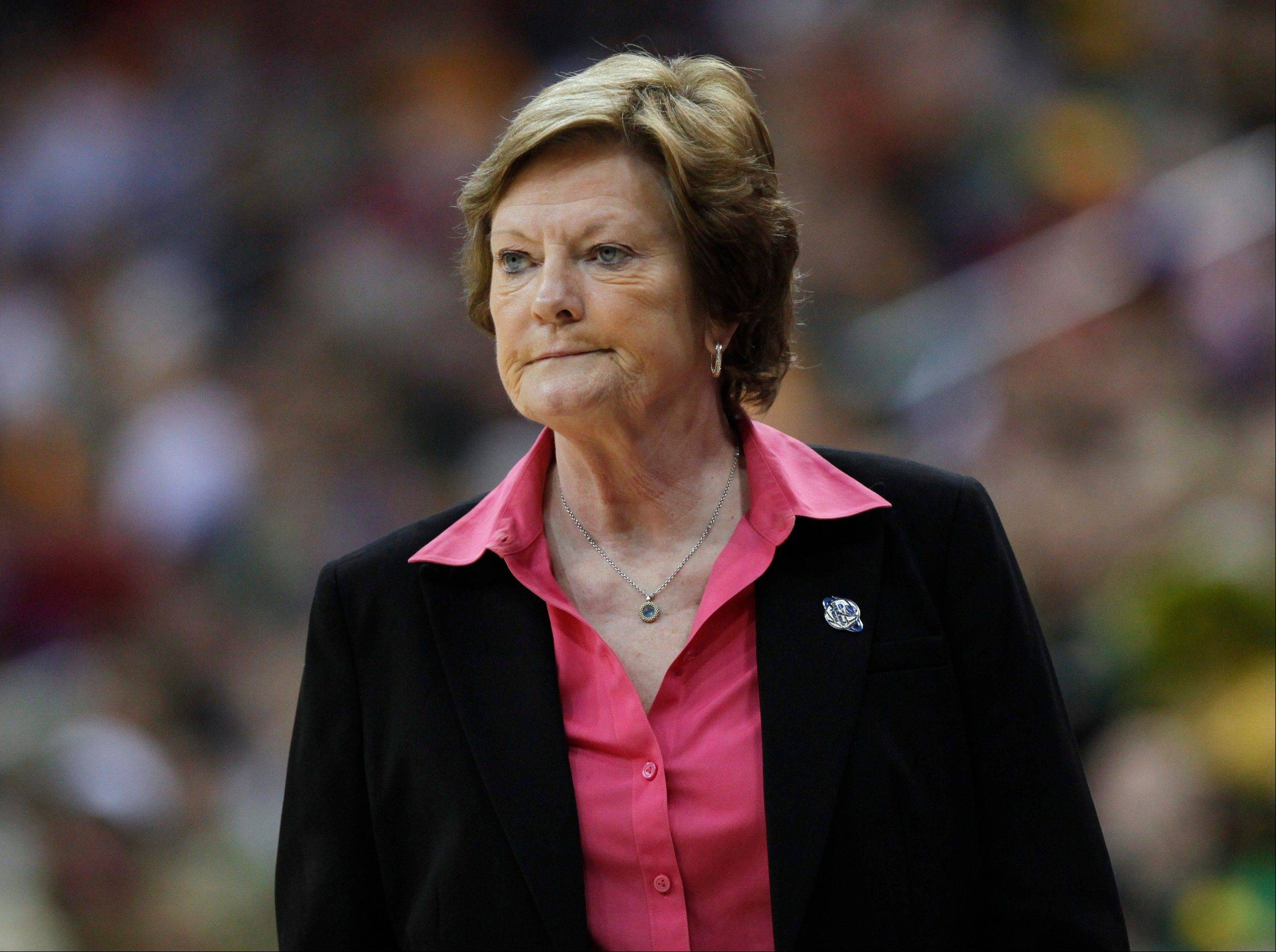 Tennessee coach Pat Summitt follows her players in the second half of an NCAA women�s regional final against Baylor on March 26. The loss was Summitt�s last game as head coach.