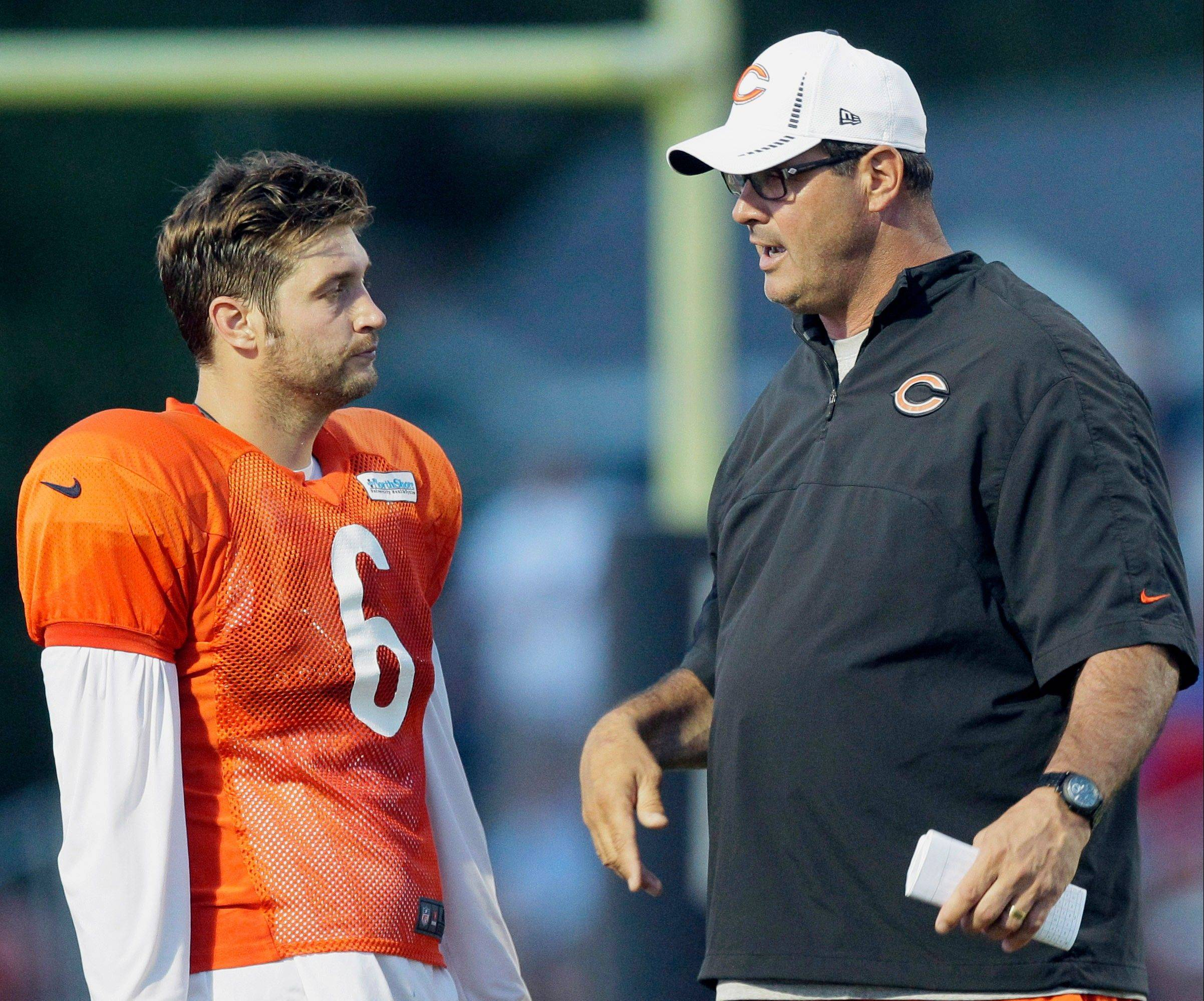 Bears offensive coordinator Mike Tice, right, insists that he was not angry with quarterback Jay Cutler during Monday night's win at Dallas. He was upset that a third-down rush failed to gain a first down.