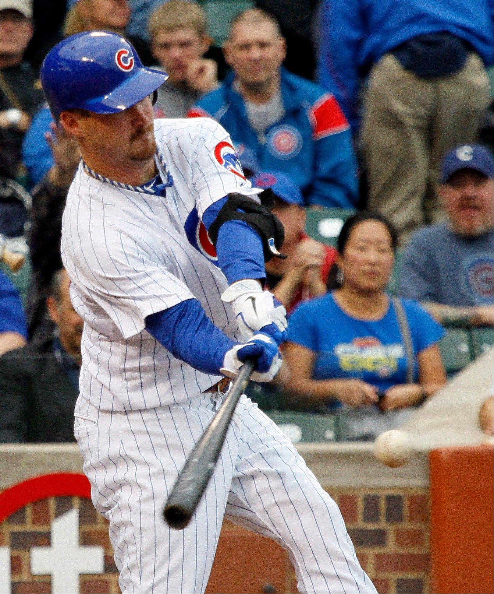 Cubs pitcher Travis Wood hits a two-run single off Houston Astros starting pitcher Edgar Gonzalez Wednesday during the fourth inning at Wrigley Field.