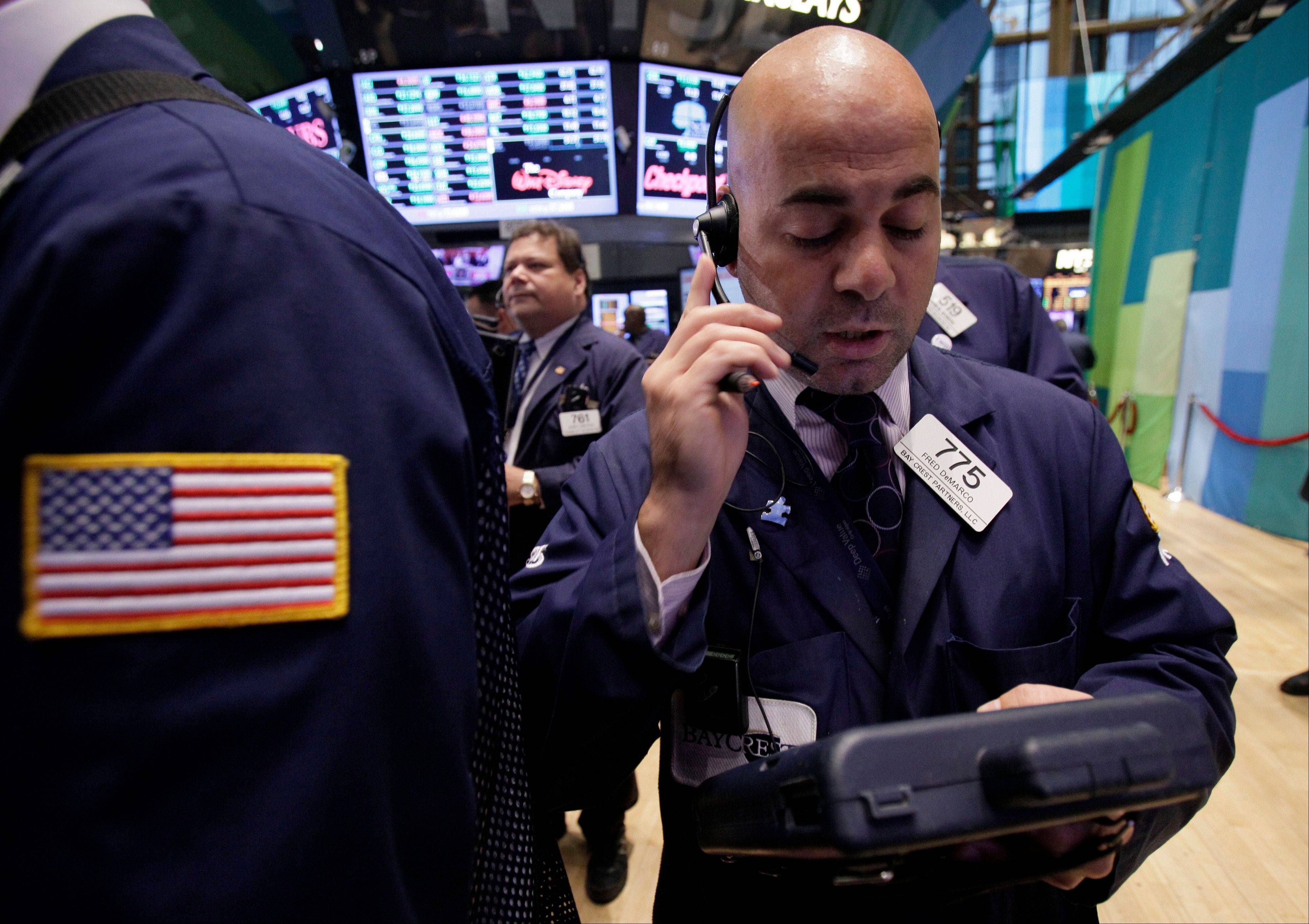 Trader Fred Demarco works on the floor of the New York Stock Exchane on Wednesday. Stocks are mostly higher in early trading on Wall Street Wednesday after a measure of private sector hiring came in better than economists were expecting.