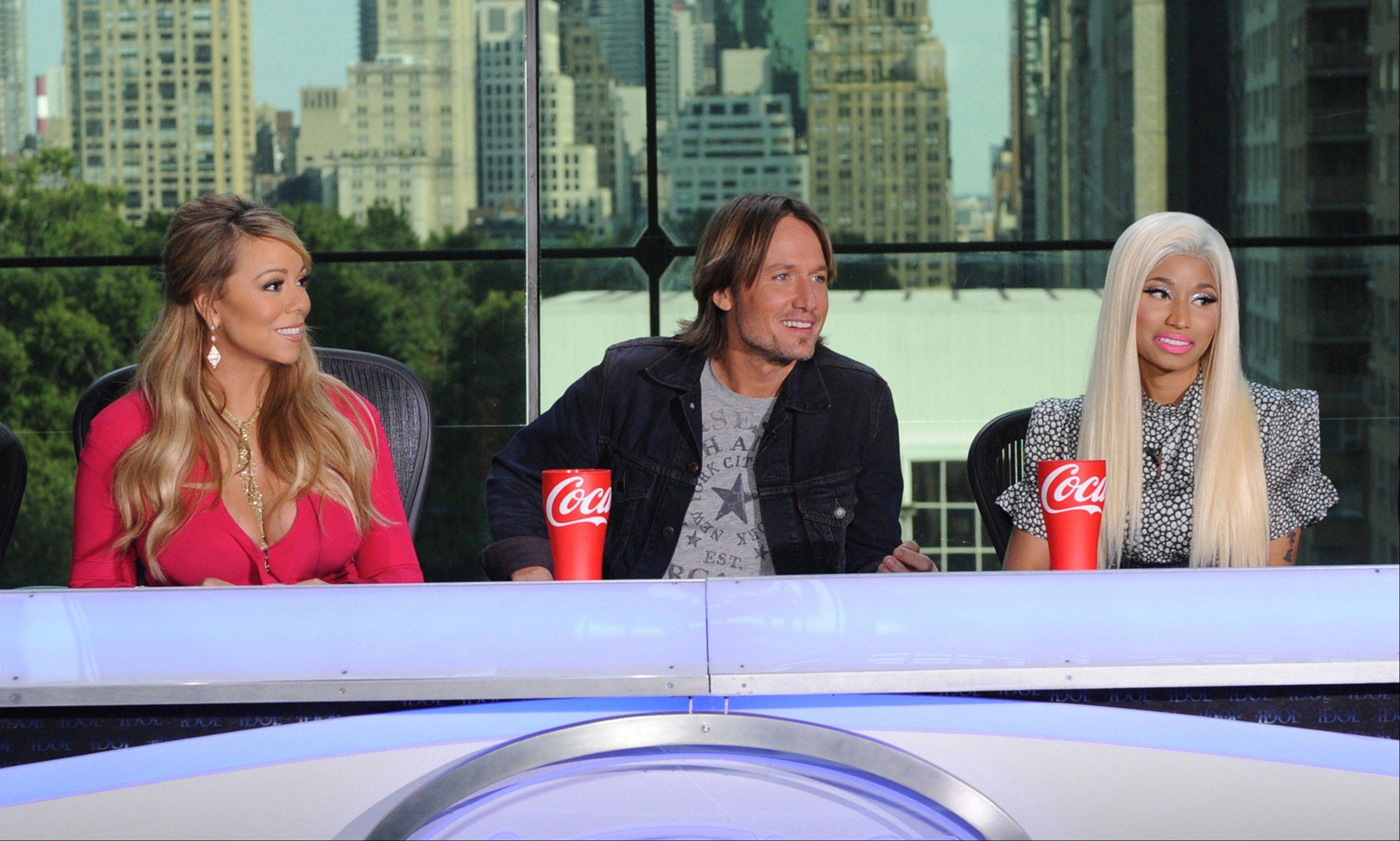 "Sparks are already flying for new judges Mariah Carey, left, Keith Urban and Nicki Minaj on the singing competition series, ""American Idol."""