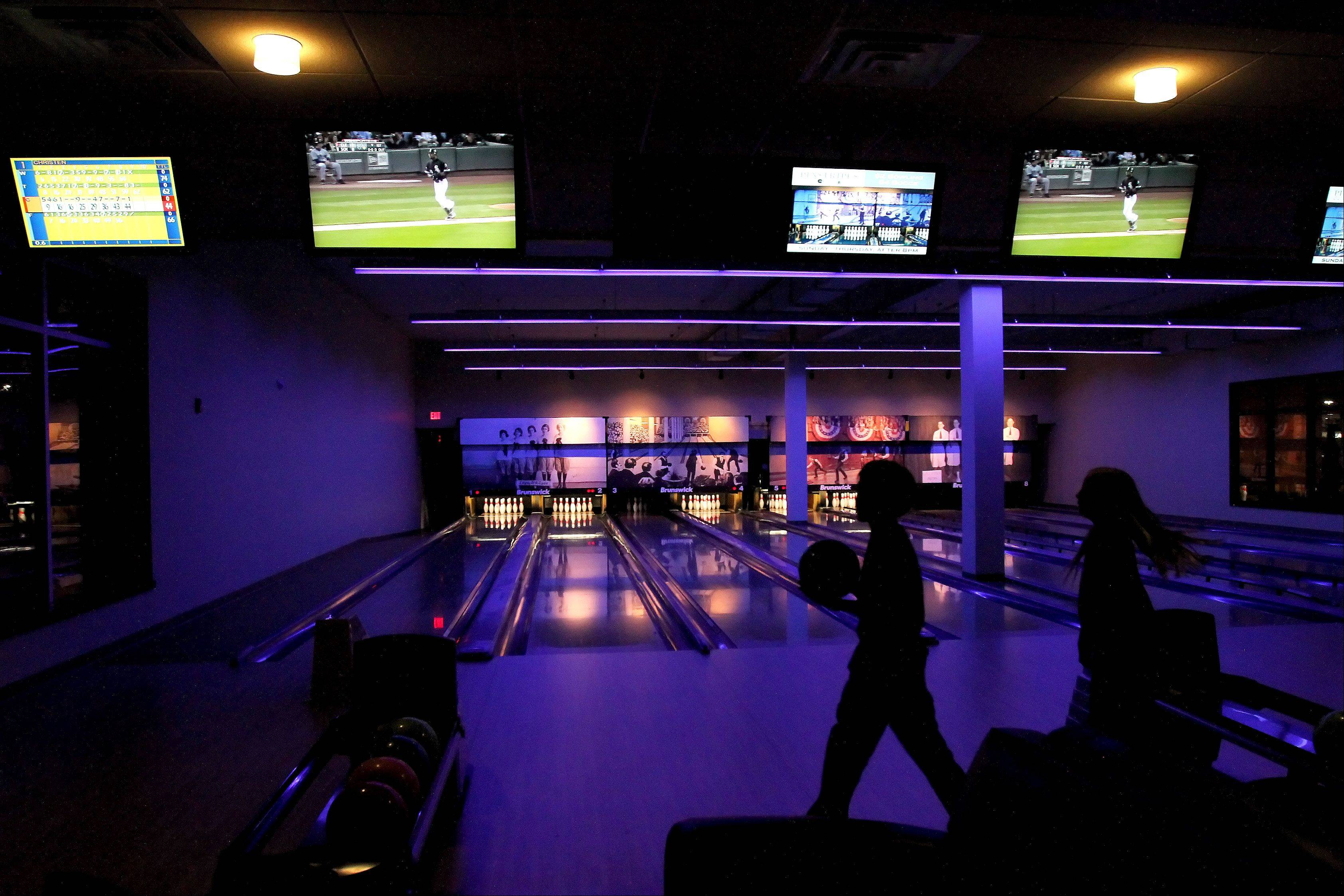 Patrons of Pinstripes in Oak Brook can play bowling or bocce, watch TV and enjoy drinks and food.