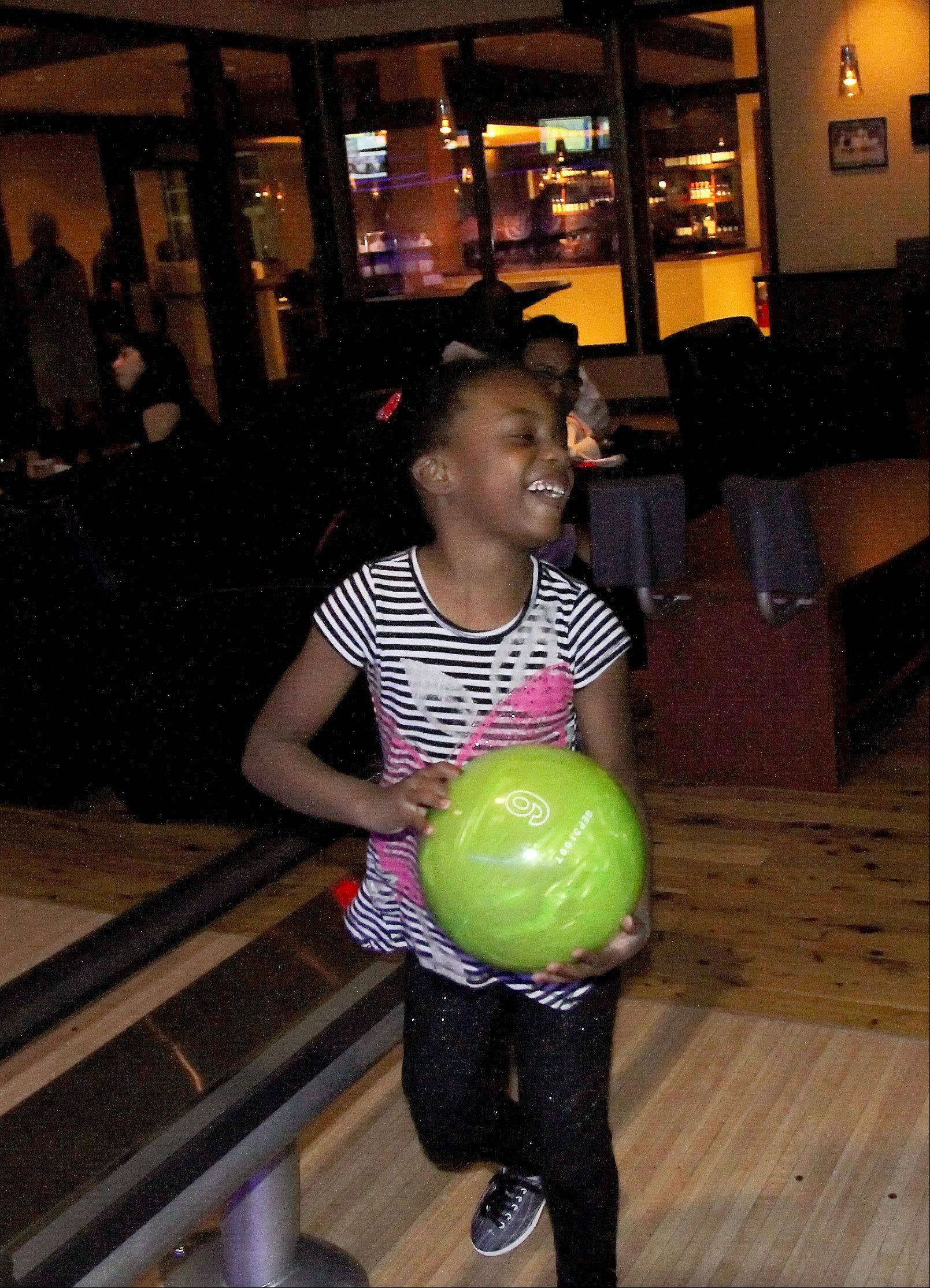 Sanai Helms, 5, of Clarendon Hills, has fun bowling at Pinstripes in Oak Brook.