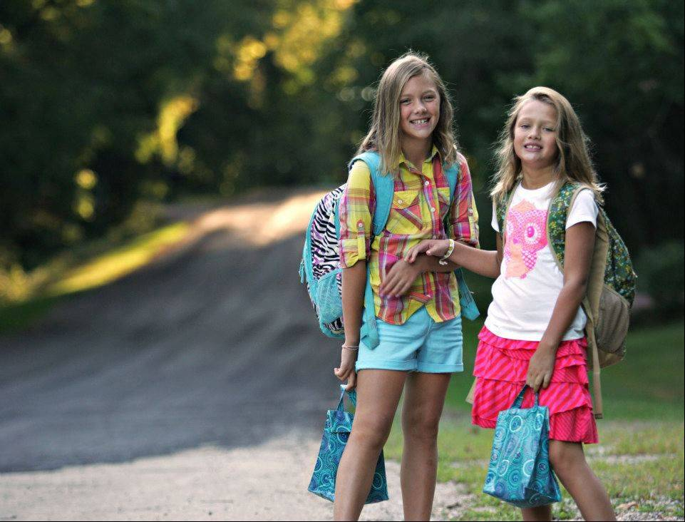 On the first day of school, I once again went to the longer lens to keep the focus on the girls and let the background fade out behind. But I did ask them to stand near their bus stop where I could see the sunrise peeking through the trees farther up our street.