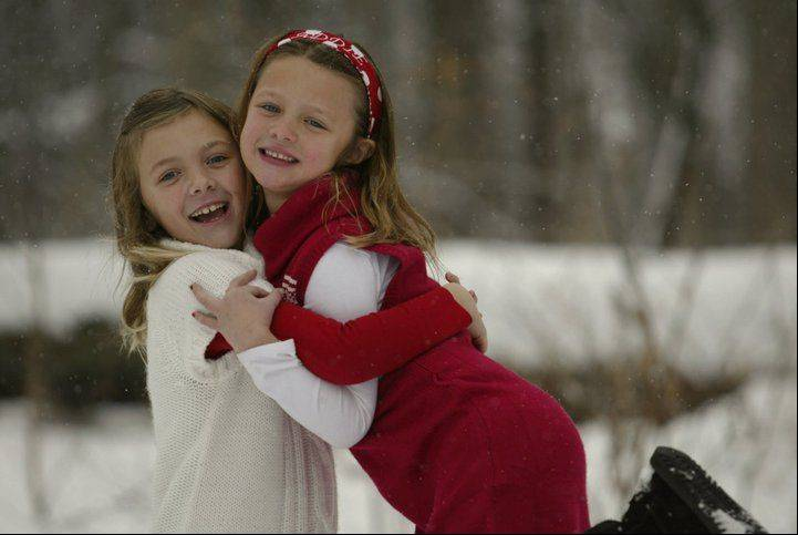 For this winter portrait of my daughters, Clare and Addie, I used a telephoto lens to minimize the focus of the woods in the background, then just told them to have fun. Clare lifting Addie off the ground was her own idea.