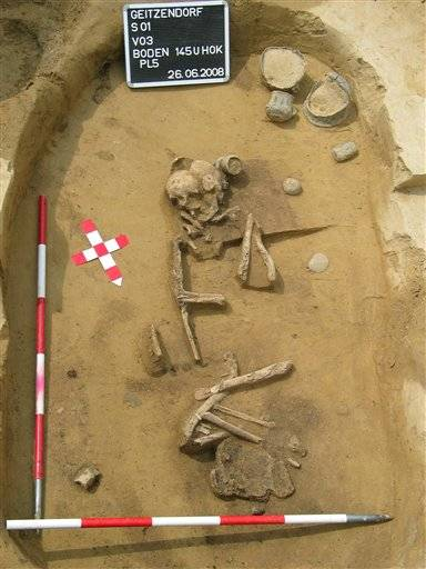 The remains of a woman in a grave in Geitzendorf, northwest of Vienna, Austria. The museum says the skeletal remains in the ancient grave are that of a woman metal worker _ the first indication that women did such work thousands of years ago.