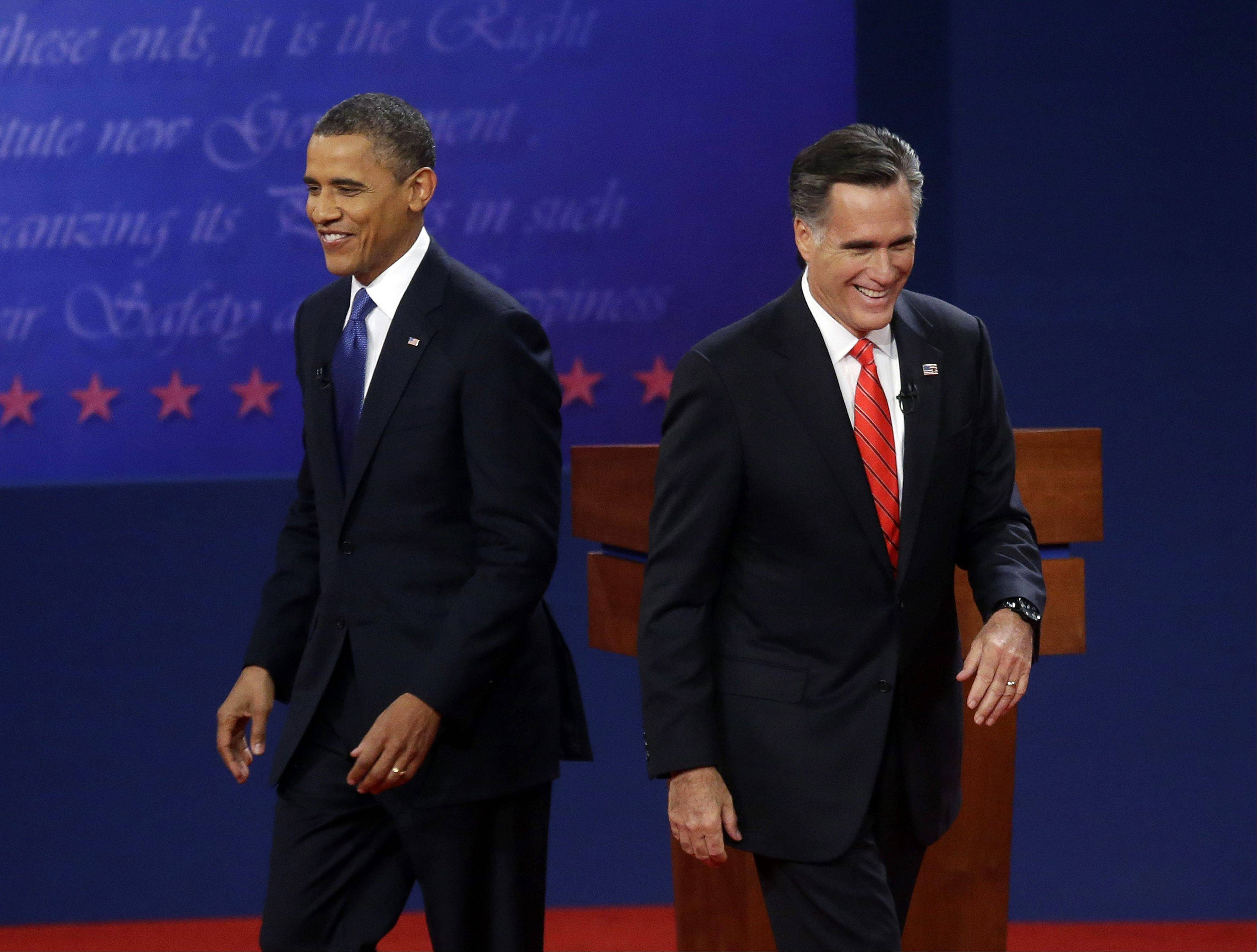 Republican presidential candidate, former Massachusetts Gov. Mitt Romney, right, and President Barack Obama, left, walk on stage at the end of their first debate Wednesday night at the University of Denver in Denver.