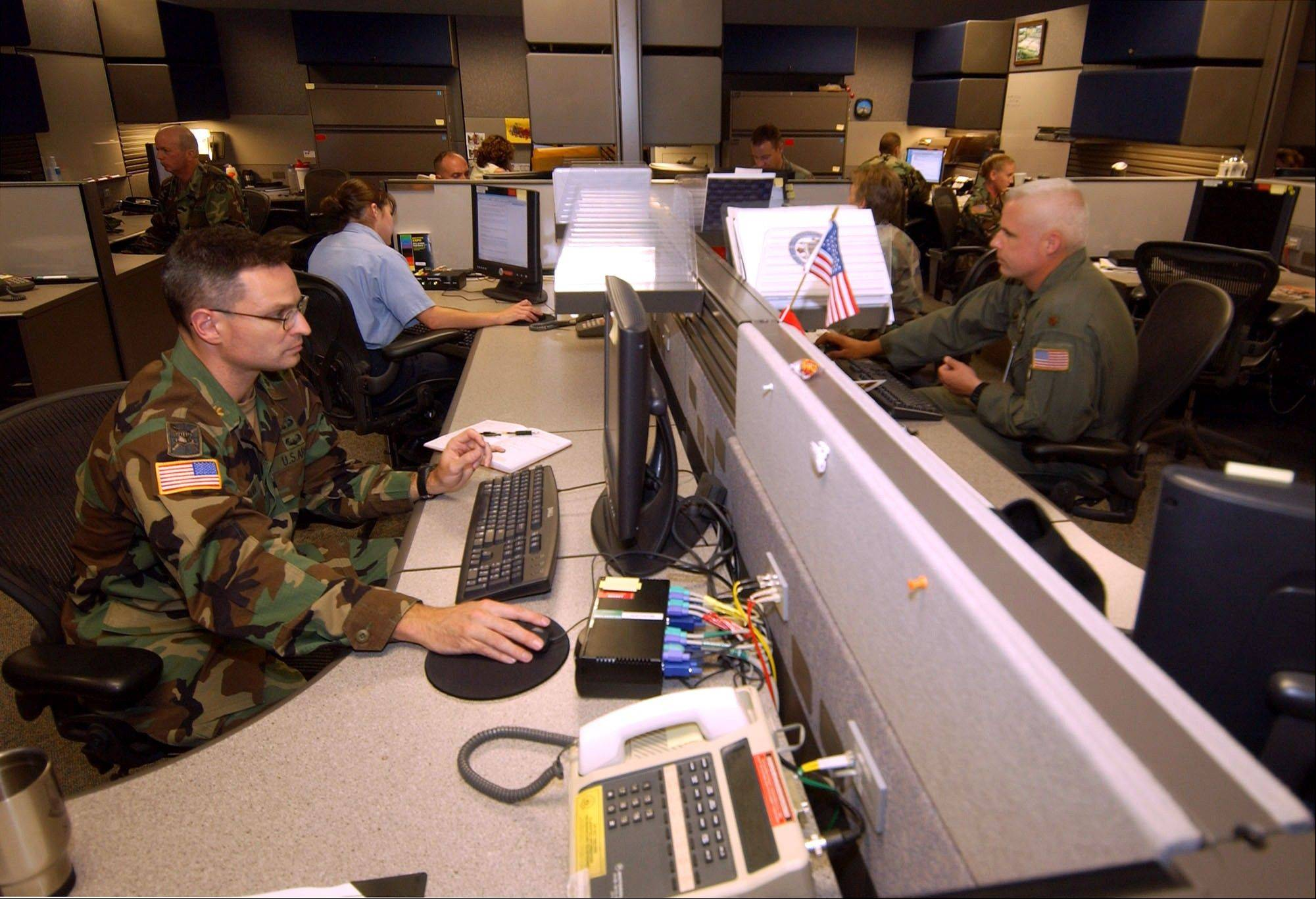 This Aug. 25, 2004 file photo shows unidentified analysts at the Combined Intelligence and Fusion Center for NORAD/Northcom in Colorado Springs, Colo. A multibillion-dollar information-sharing program that was created in the aftermath of Sept. 11 has improperly collected information about innocent Americans and produced no valuable intelligence on terrorism, according to a Senate report that describes an effort that ballooned far beyond anyone�s ability to control.