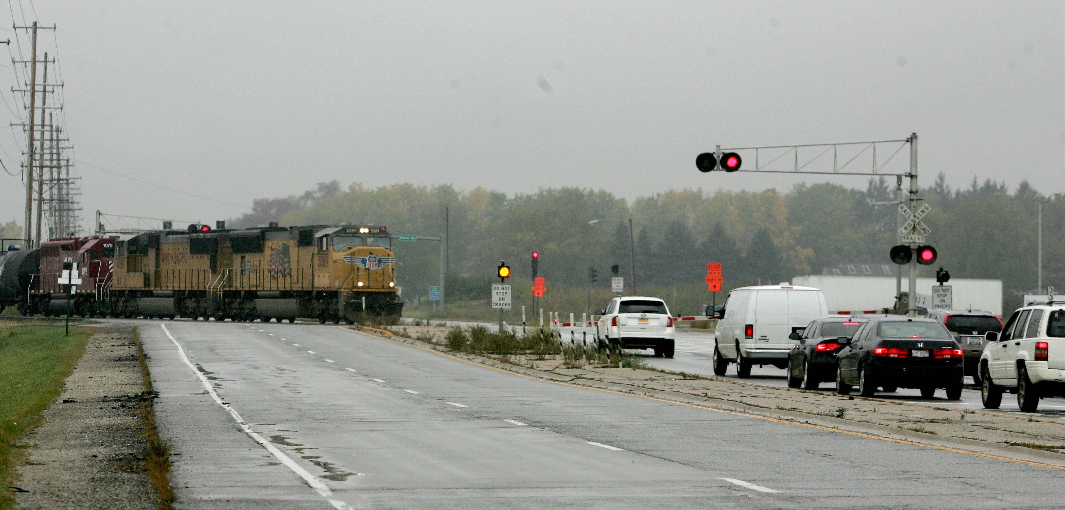 A nearly $26 million overpass, to be completed in two years, will carry vehicles over the railroad crossing on Route 38, near Kautz Road.