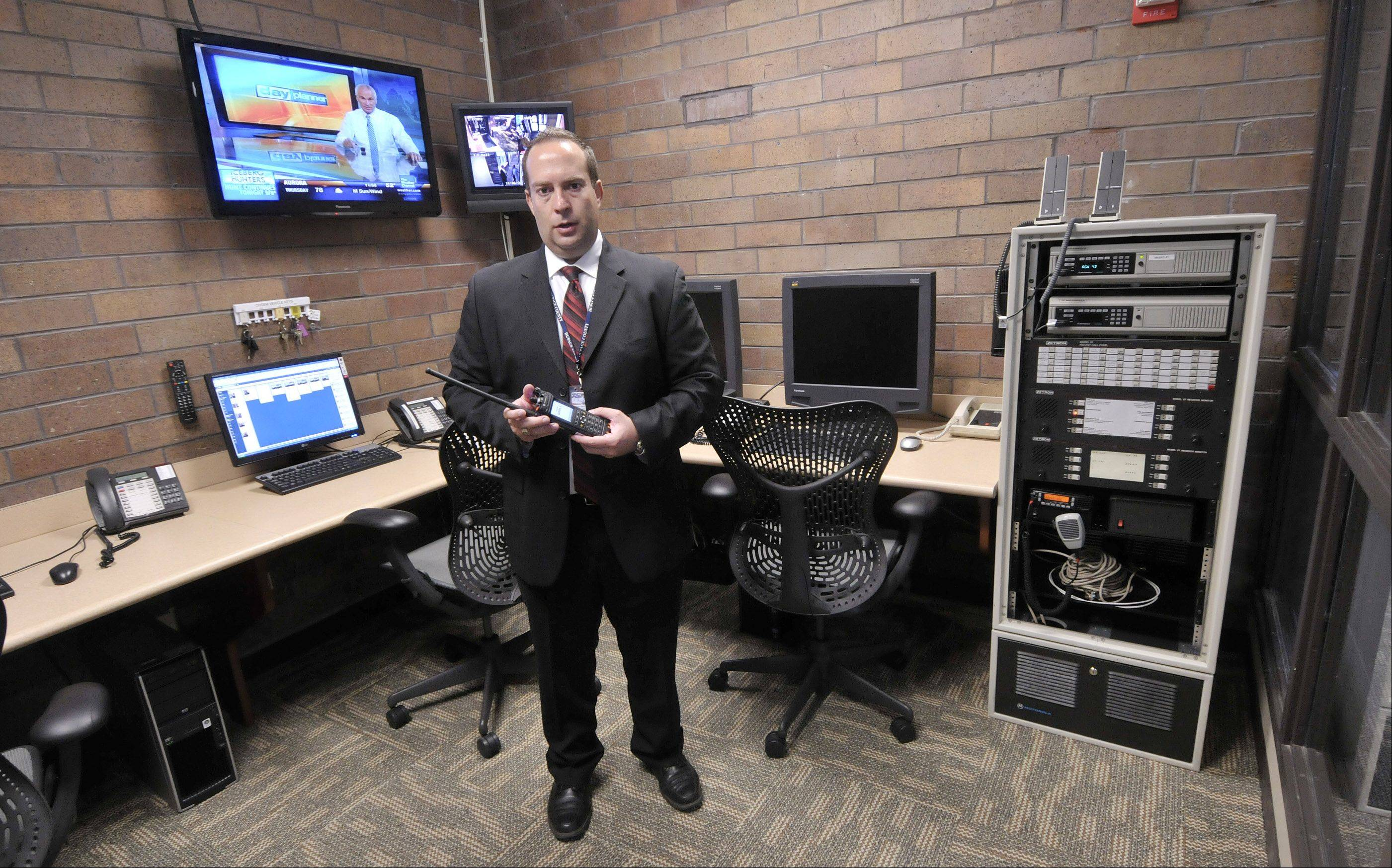 David Gervino, emergency management coordinator for DuPage County's Office of Homeland Security and Emergency Management, talks about radio capabilities of the new emergency operations center. In the radio room, county officials can communicate with police and fire departments throughout the state to coordinate the response to big emergencies.