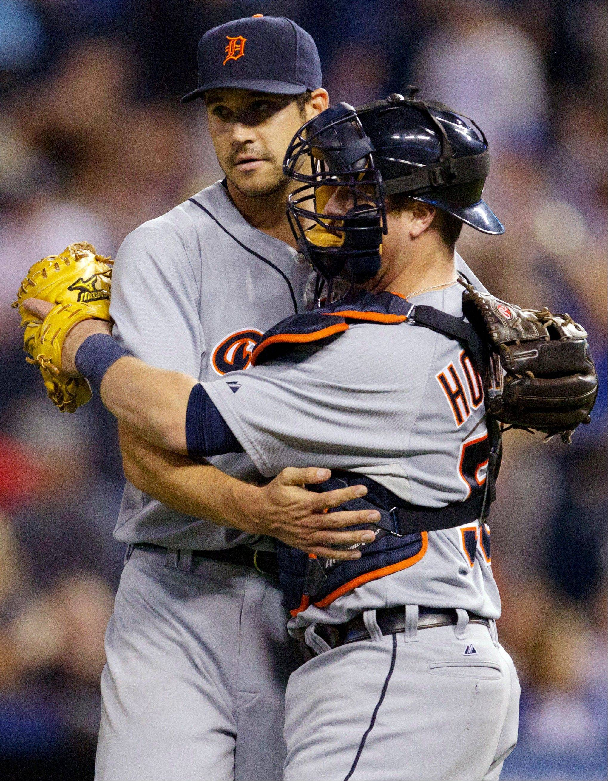 Detroit Tigers relief pitcher Luke Putkonen, left, is congratulated by catcher Bryan Holaday following their 1-0 win over the Kansas City Royals on Wednesday.