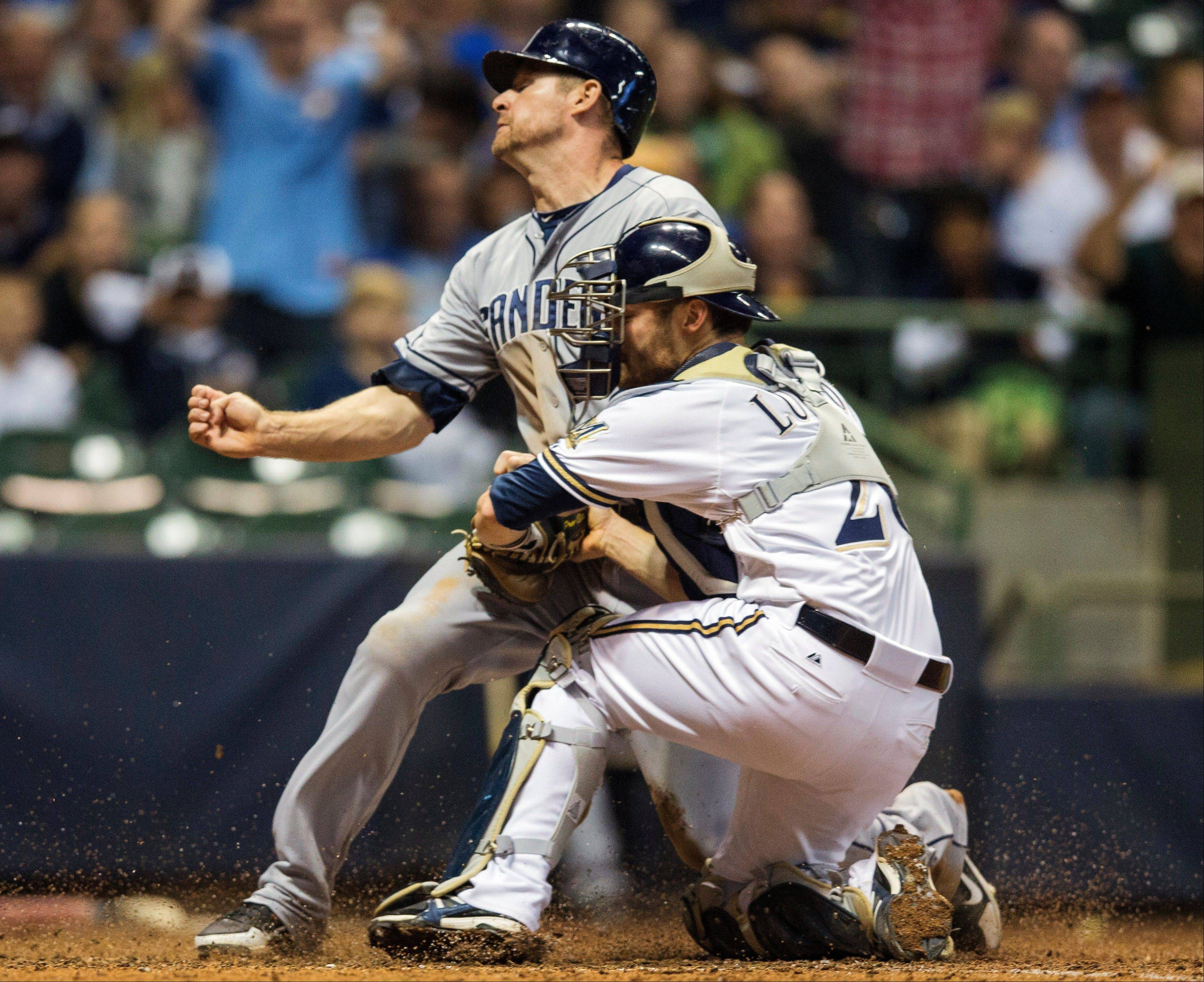 The Padres' Chase Headley beats the tag at home from the Brewers' Jonathan Lucroy during the seventh inning Wednesday in Milwaukee.