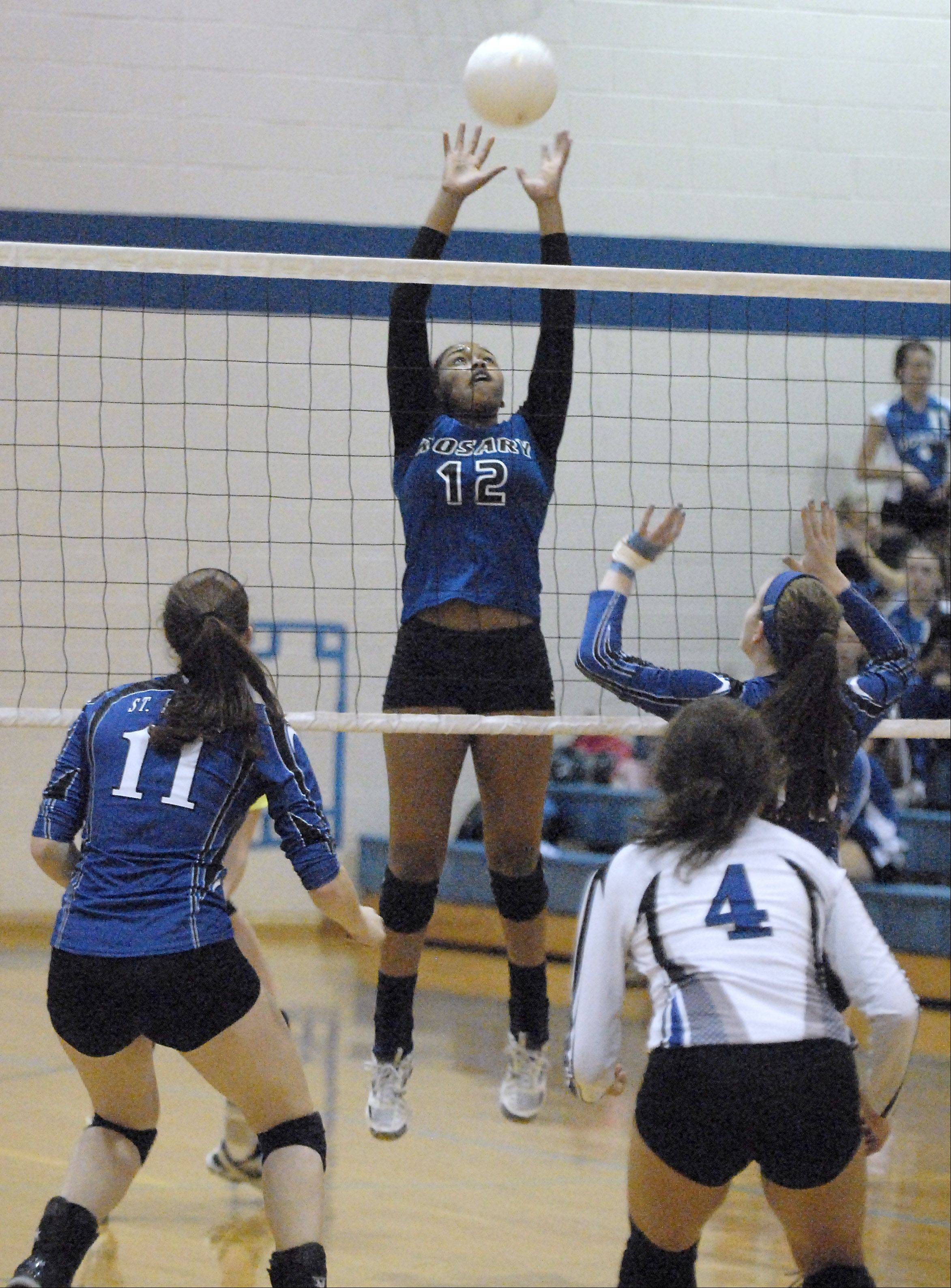 Rosary's Briana Flagg sends the ball over to St. Francis in the first game on Wednesday, October 3.