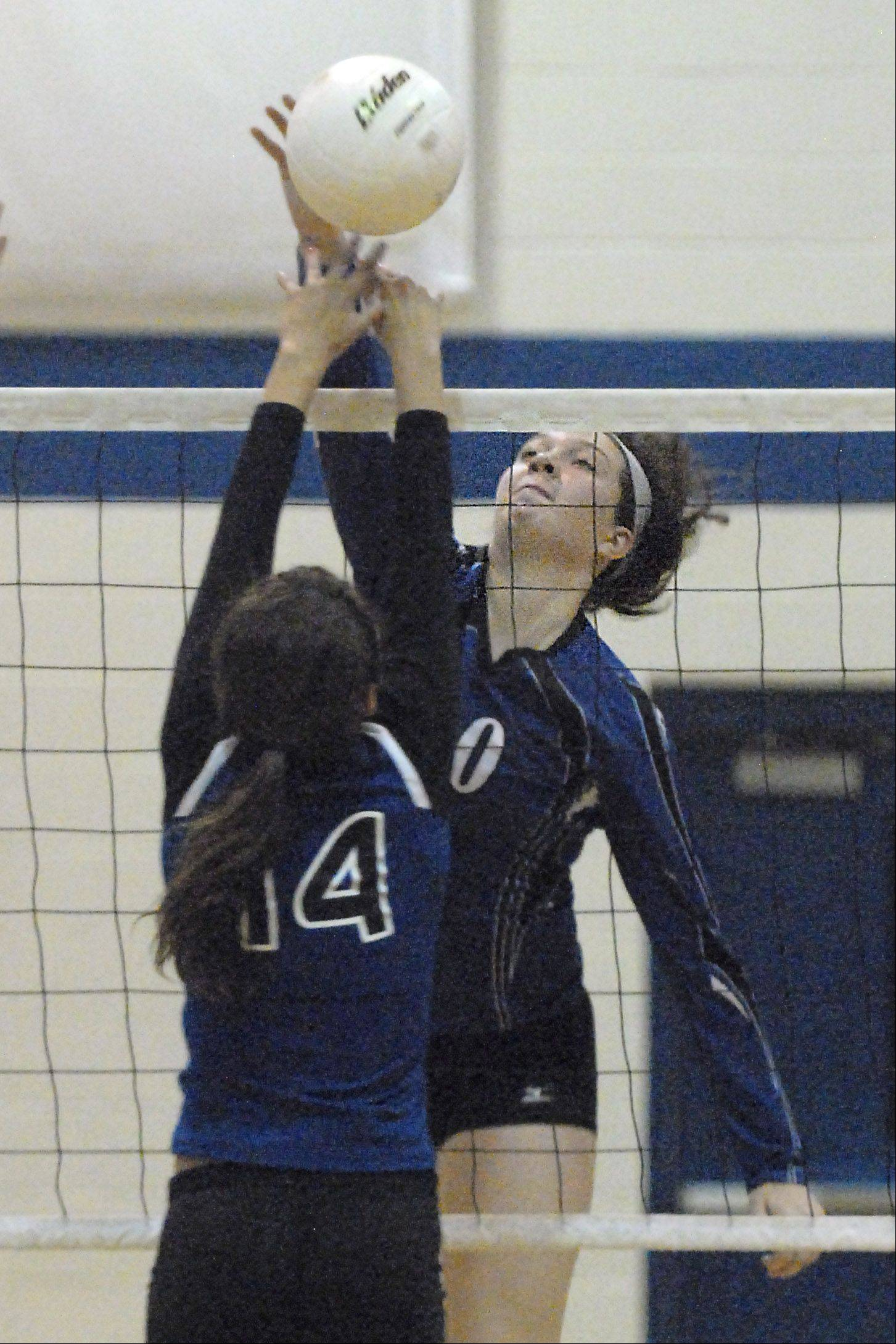 St. Francis' Molly Haggerty tips the ball over to Rosary in the second game on Wednesday, October 3. 40 2