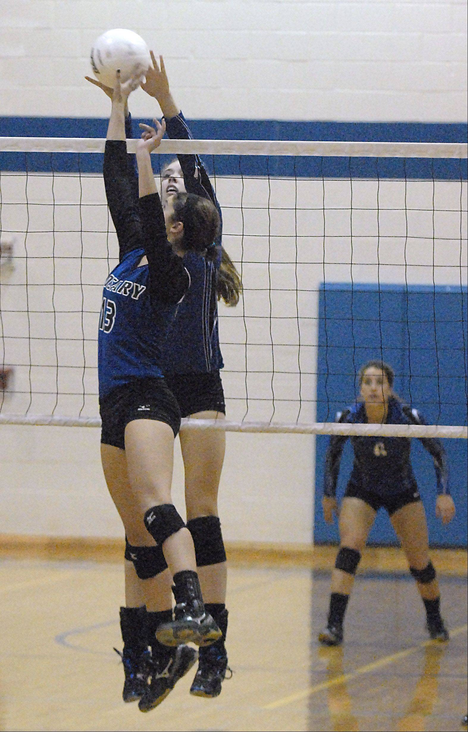 Rosary's Josephine Gallagher tips the ball over the net while St. Francis' Mary Boken sets a block in the second game on Wednesday, October 3.