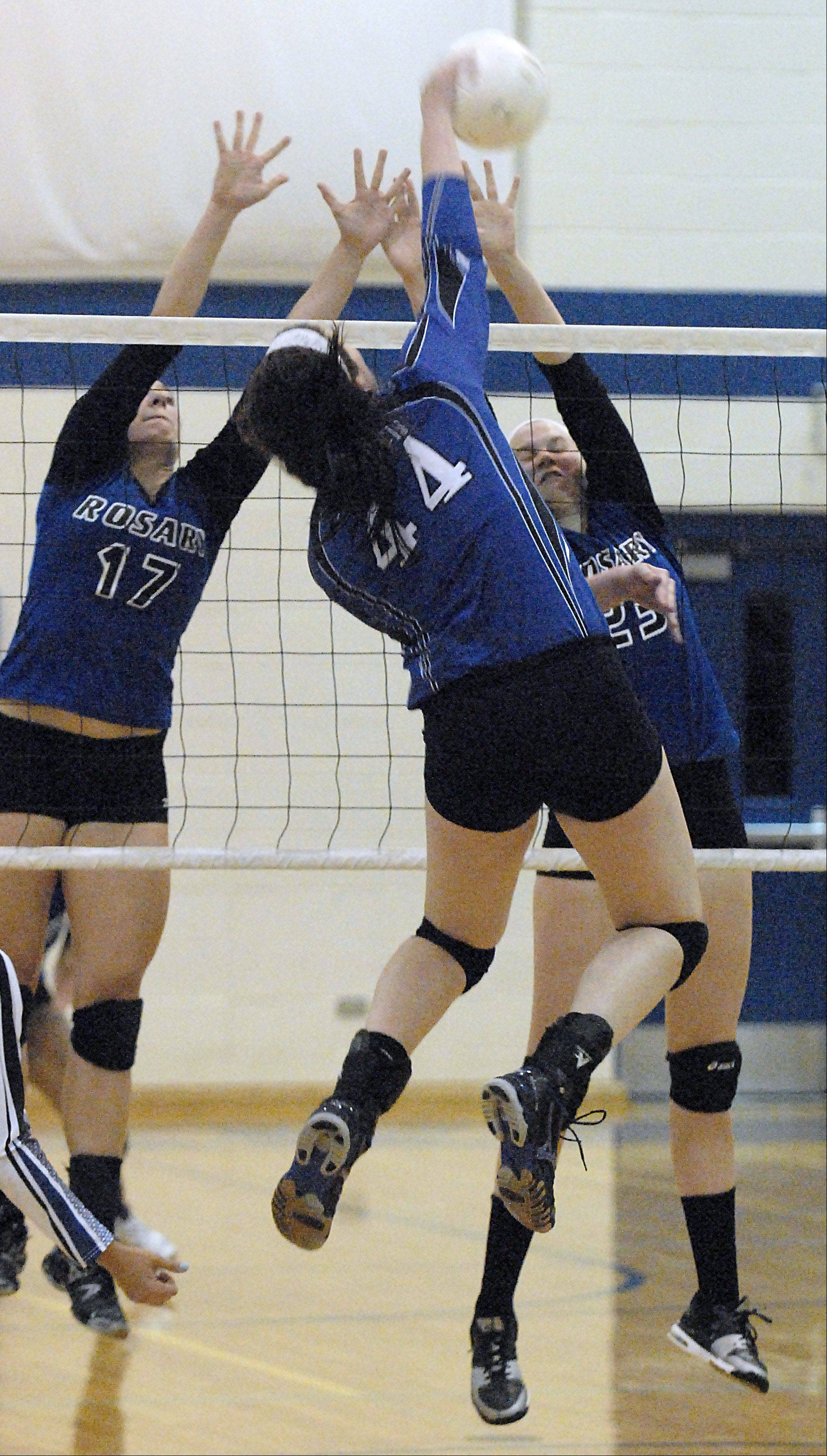 St. Francis' Maddie Haggerty spikes over the net toward Rosary's Kate Stefanski Michaela Ping in the first game on Wednesday, October 3.