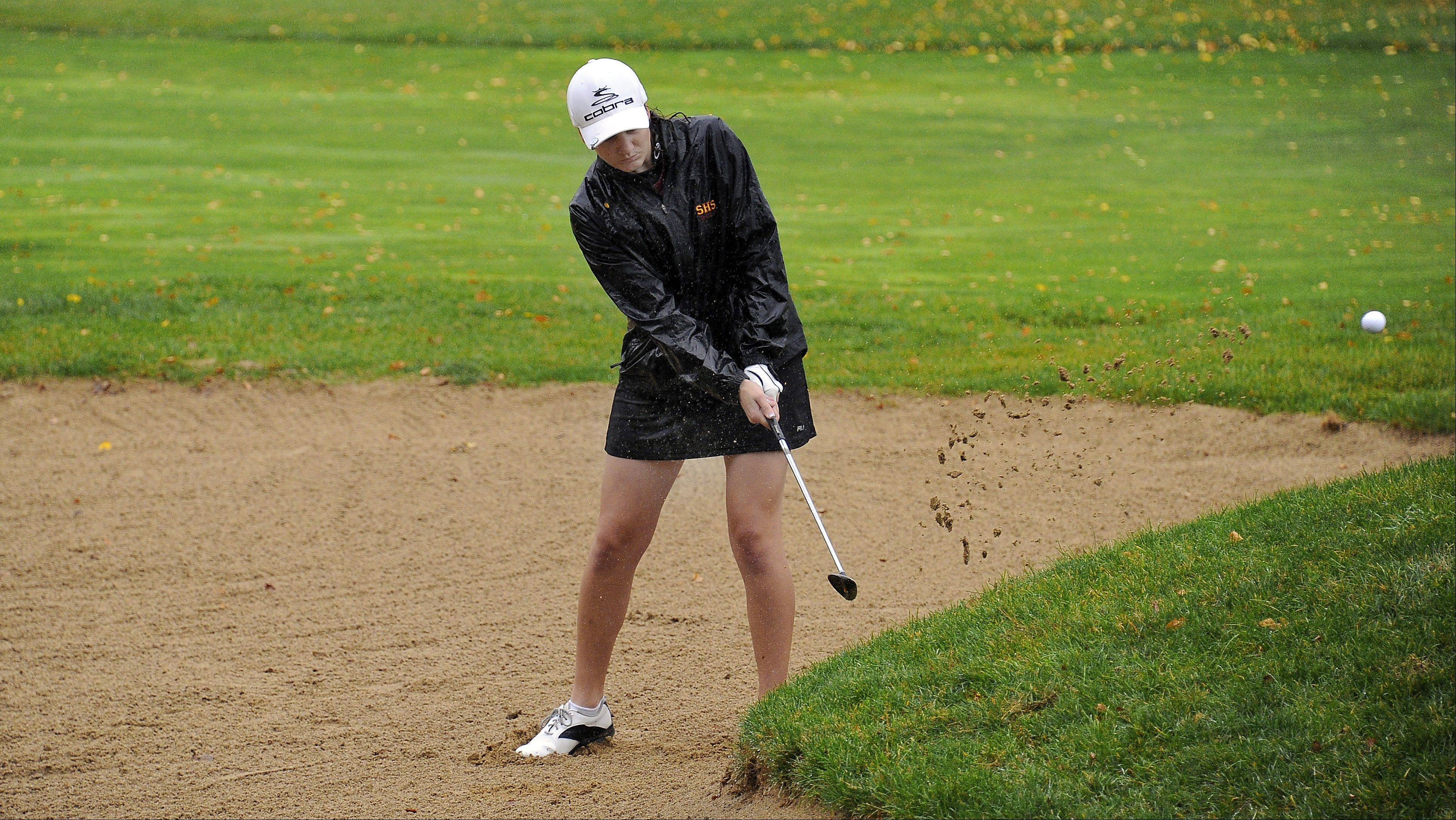 Schaumburg's Emily Santucci chips up from the sand trap up on the green on the back nine at the girls golf regional held at Bridges of Poplar Creek Country Club on Wednesday.