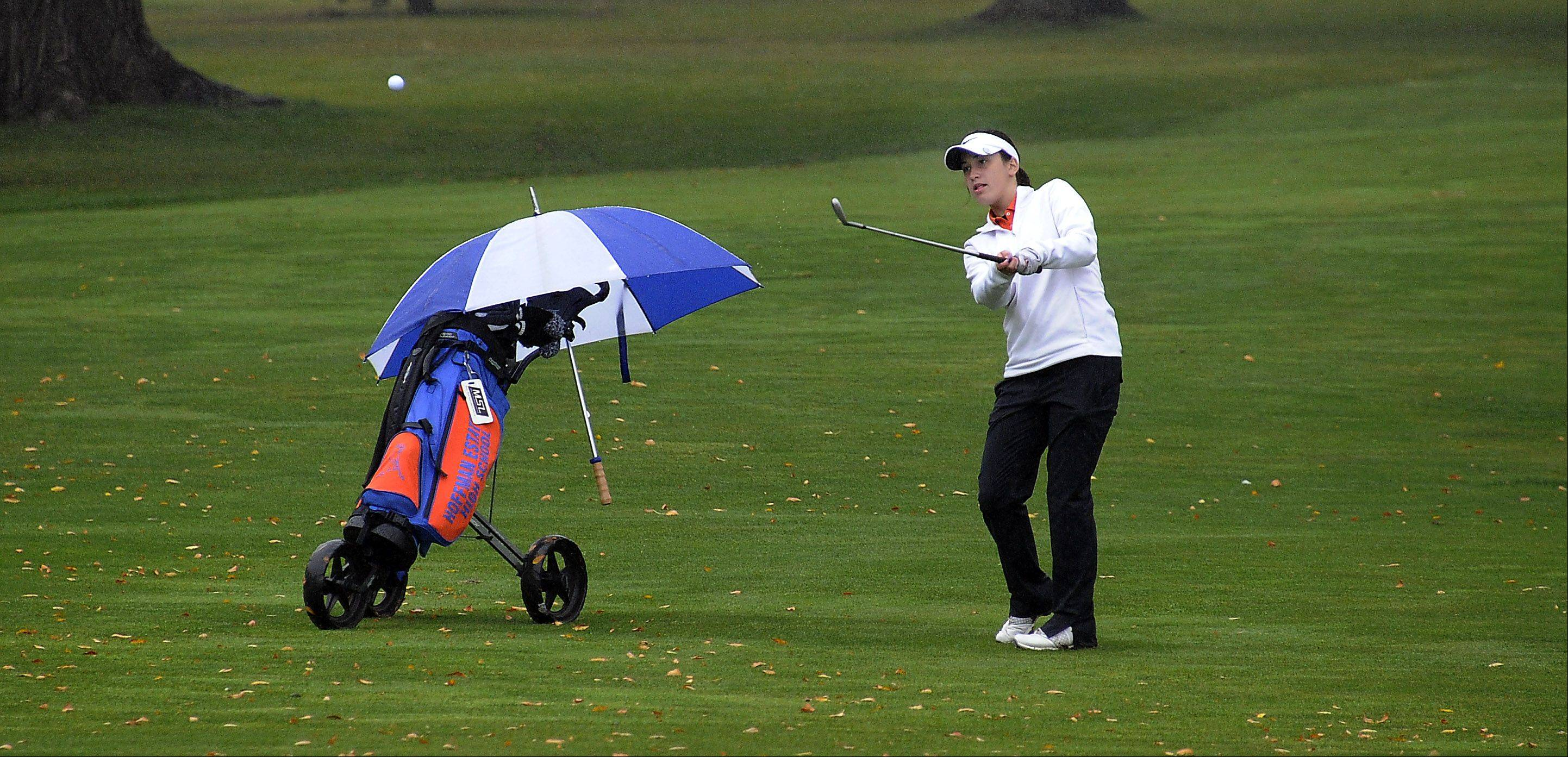 Hoffman Estates Hannah Brostoff chips up from the rough to the green on the back nine at the girls golf regional held at Bridges of Poplar Creek Country Club on Wednesday.
