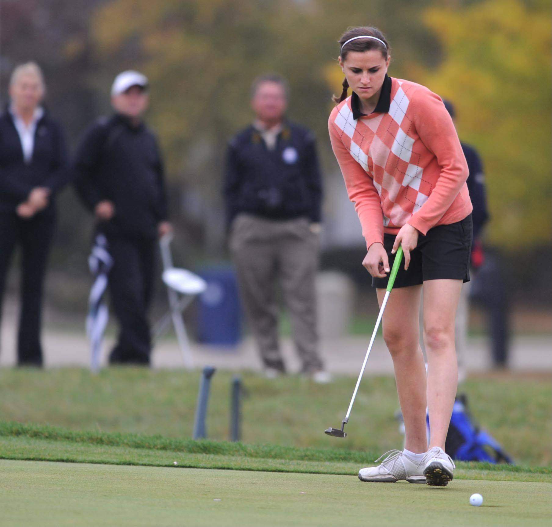 St. Charles East's Paige Jordan watches her putt drop on the second green at the Regional golf tournament Wednesday at the Golf Club of Illinois in Algonquin.