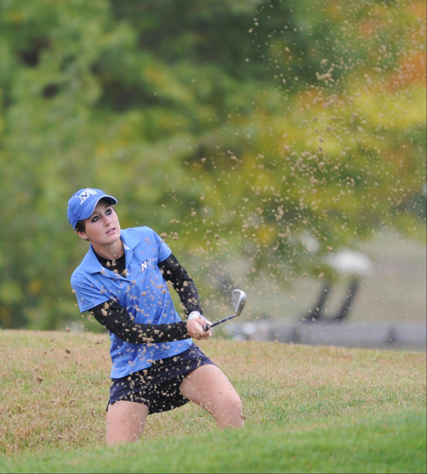 St. Charles North's Ariana Furrie blasts out of the bunker on the first hole at the Regional golf tournament Wednesday at the Golf Club of Illinois in Algonquin.