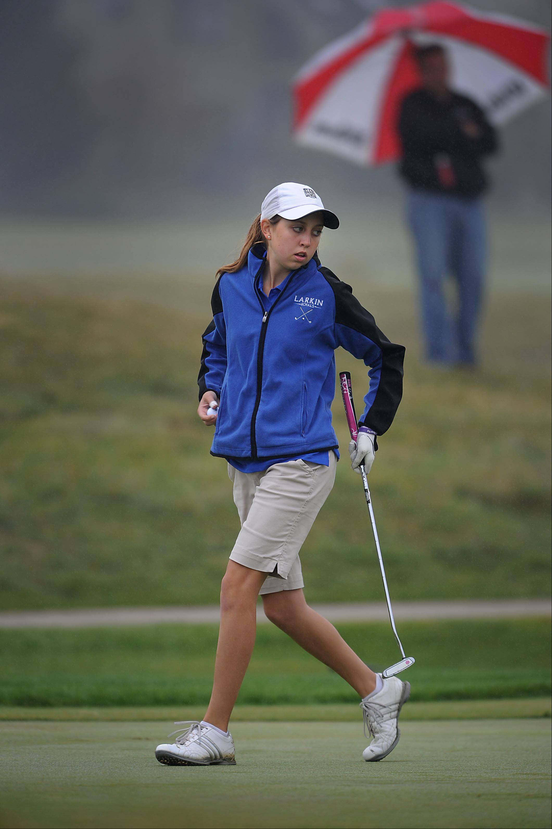 Larkin's Allison Smith in the rain at the Regional golf tournament Wednesday at the Golf Club of Illinois in Algonquin.
