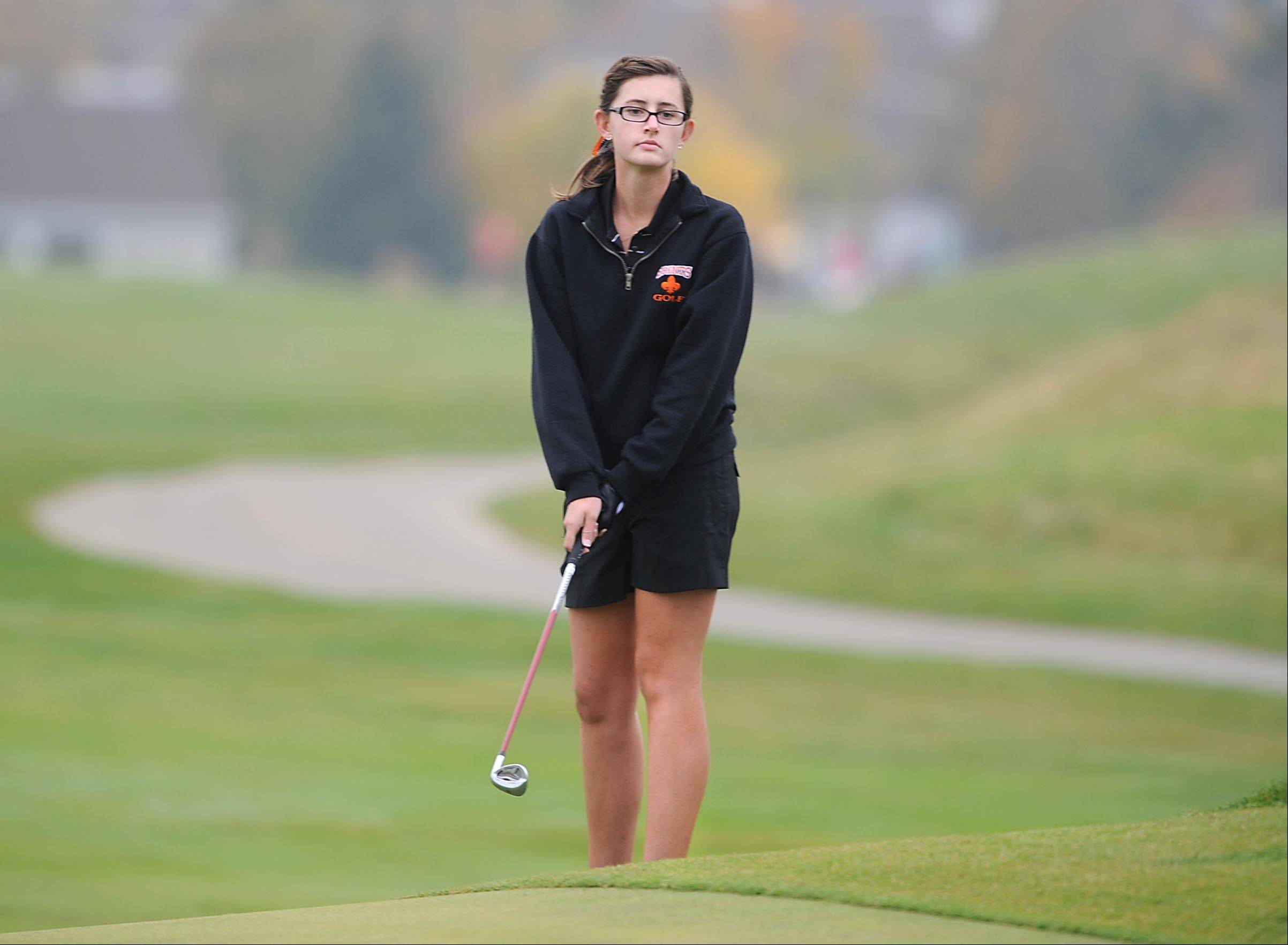 St. Charles East's Darby Crane follows her chip at the Regional golf tournament Wednesday at the Golf Club of Illinois in Algonquin.