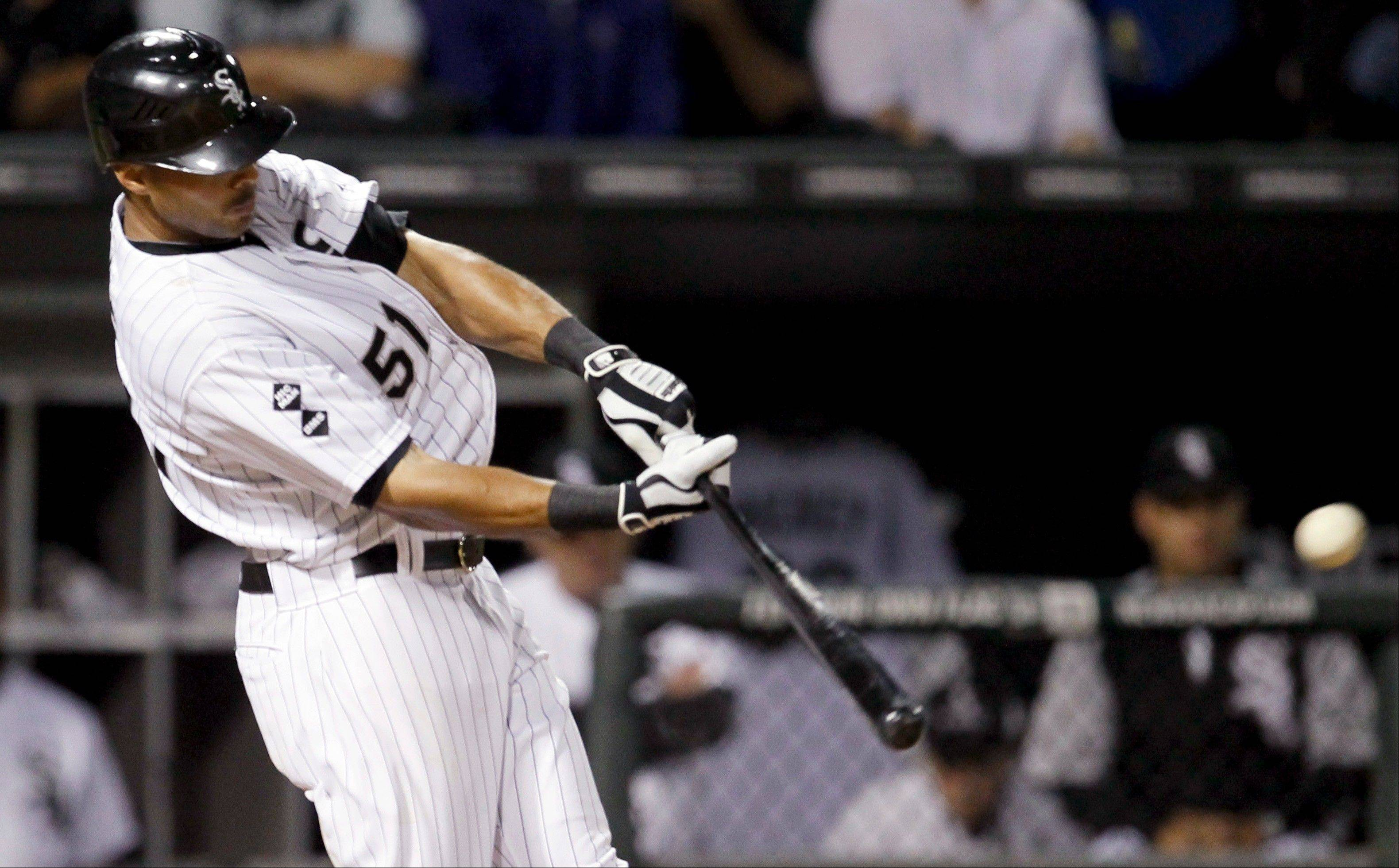 The White Sox' Alex Rios hits a 3-run homer against Detroit.