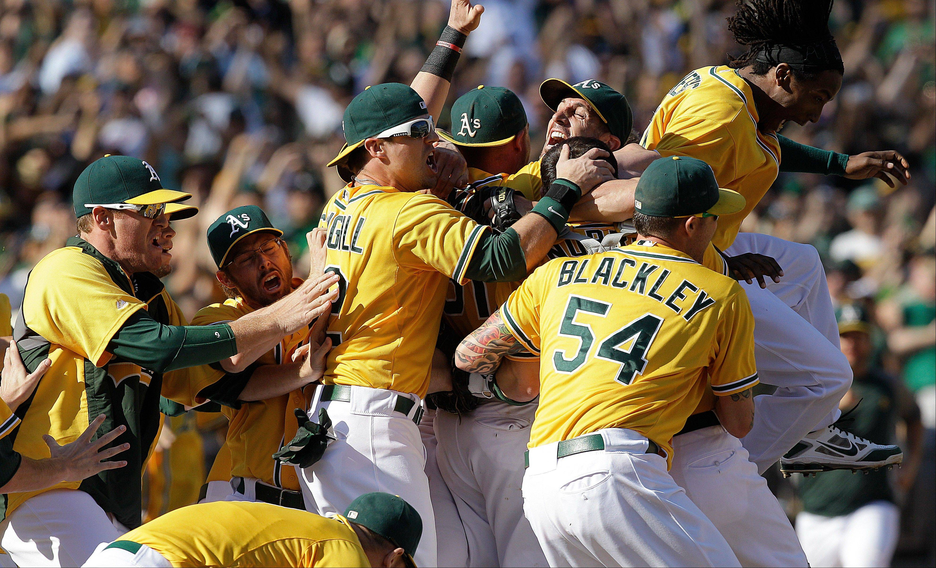 Oakland Athletics players celebrate after clinching the American League West at home Wednesday.