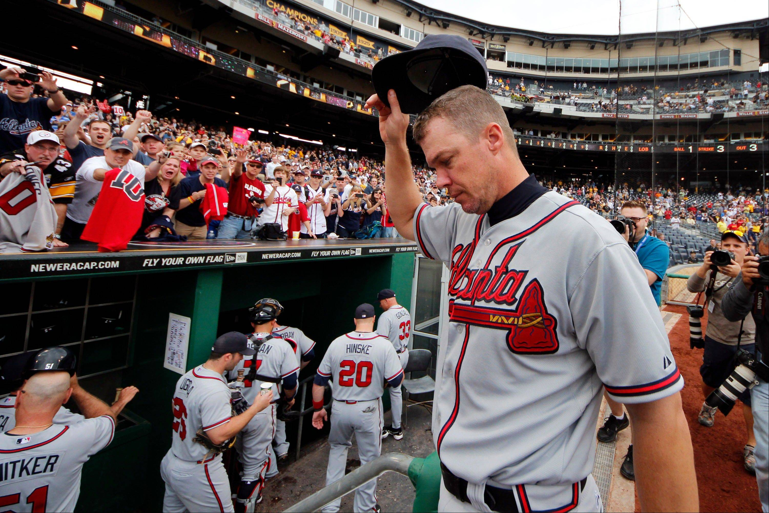 Atlanta Braves third baseman Chipper Jones acknowledges fans as he heads for the locker room Wednesday following a 4-0 win over the Pittsburgh Pirates in the final game of the regular baseball season in Pittsburgh.